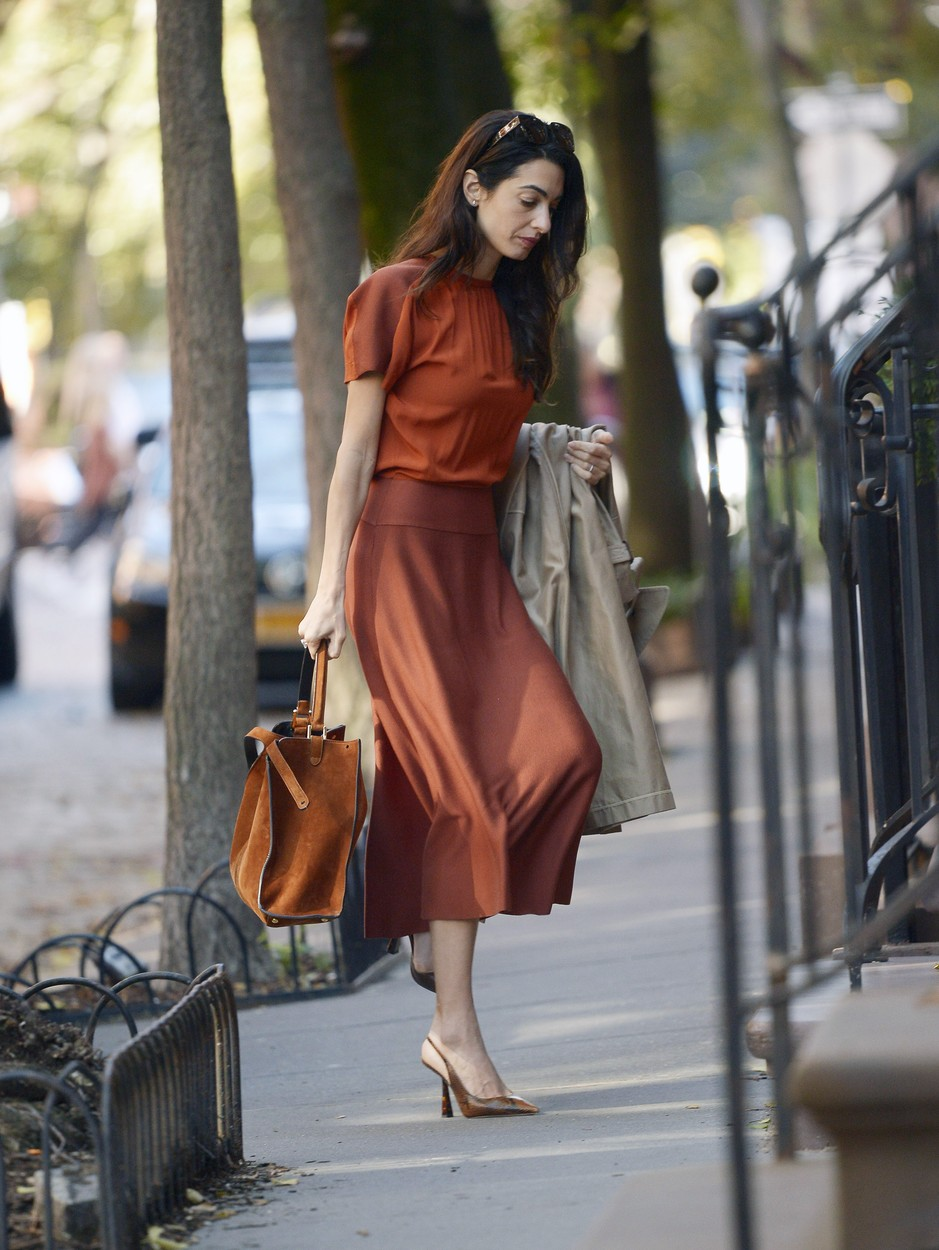 10/28/2019 EXCLUSIVE: Amal Clooney steps out looking fashionable in New York City. The 41 year old barrister was spotted displaying some autumn fashion while wearing a burnt orange blouse, matching skirt, snakeskin heels, and carrying a leather tote., Image: 479452368, License: Rights-managed, Restrictions: Exclusive NO usage without agreed price and terms. Please contact sales@theimagedirect.com, Model Release: no, Credit line: TheImageDirect.com / The Image Direct / Profimedia