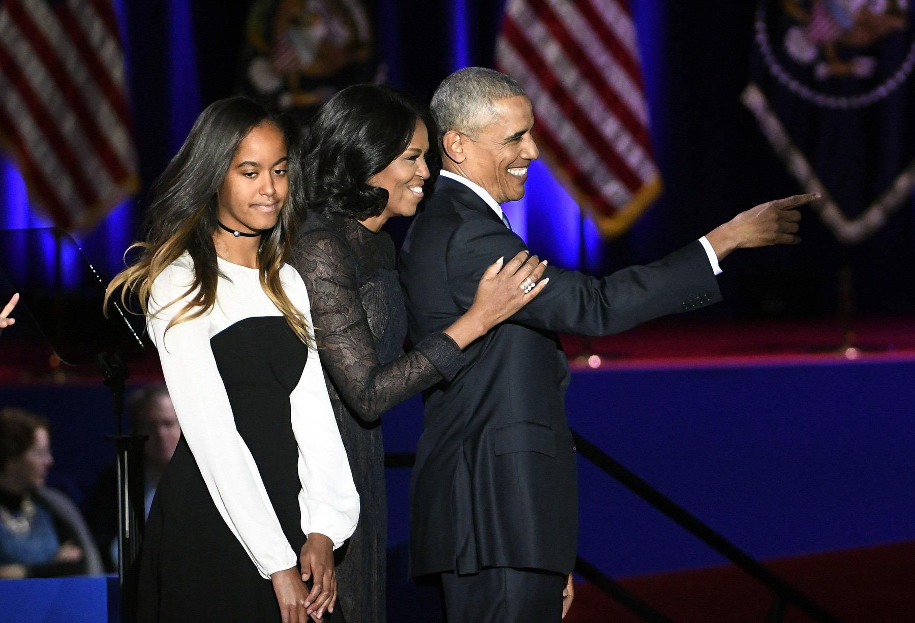 U.S. President Barack Obama (R-L) stands on stage with his wife Michelle and daughter Malia after delivering his farewell address to a crowd of supporters at McCormick Place in Chicago on January 10, 2017.      Photo by /UPI, Image: 310502957, License: Rights-managed, Restrictions: , Model Release: no, Credit line: David Banks / UPI / Profimedia