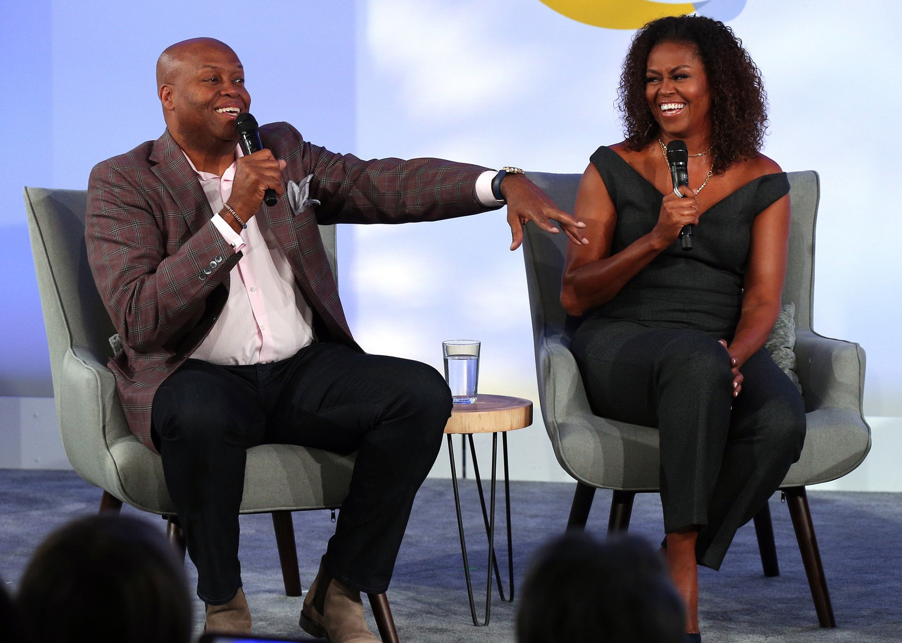 Former first lady Michelle Obama and her brother, Craig Robinson, converse during a session of the Obama Foundation Summit at the Kaplan Institute at the Illinois Institute of Technology in Chicago on Tuesday, Oct. 29, 2019., Image: 479754942, License: Rights-managed, Restrictions: *** World Rights *** US Newspapers Out ***, Model Release: no, Credit line: TNS / ddp USA / Profimedia