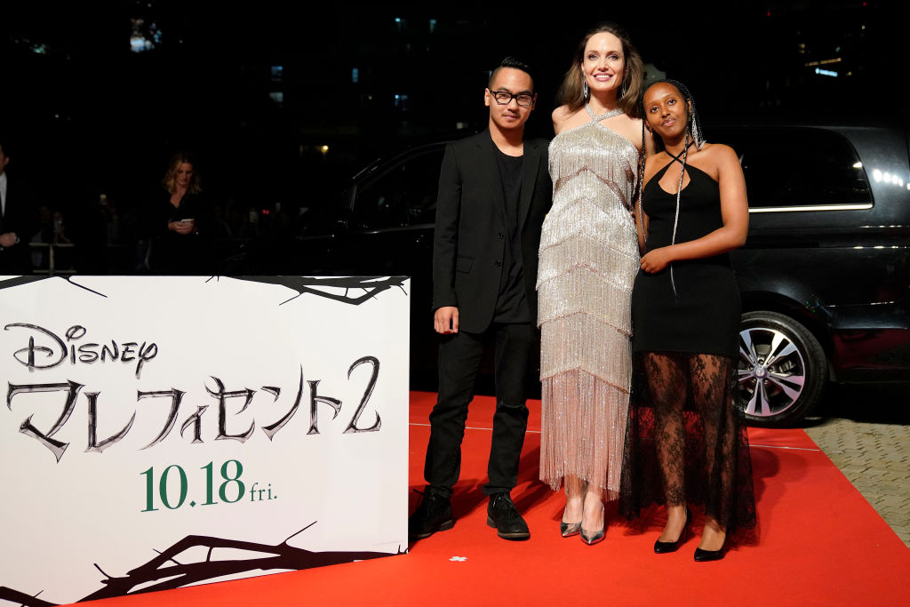 TOKYO, JAPAN - OCTOBER 03: (L-R) Maddox Jolie-Pitt, Angelina Jolie, and Zahara Jolie-Pitt attend the Japan premiere of 'Maleficent: Mistress of Evil' on October 03, 2019 in Tokyo, Japan. (Photo by Christopher Jue/Getty Images for Disney)