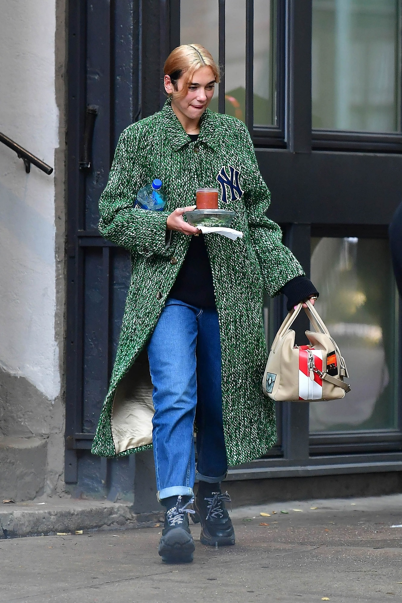 New York, Ny  - Dua Lipa wearing a green coat with NY knicks logo and carrying her own food  BACKGRID USA 3 OCTOBER 2019, Image: 475048313, License: Rights-managed, Restrictions: RIGHTS: WORLDWIDE EXCEPT IN FRANCE, GERMANY, POLAND, Model Release: no, Credit line: Skyler2018 / BACKGRID / Backgrid USA / Profimedia