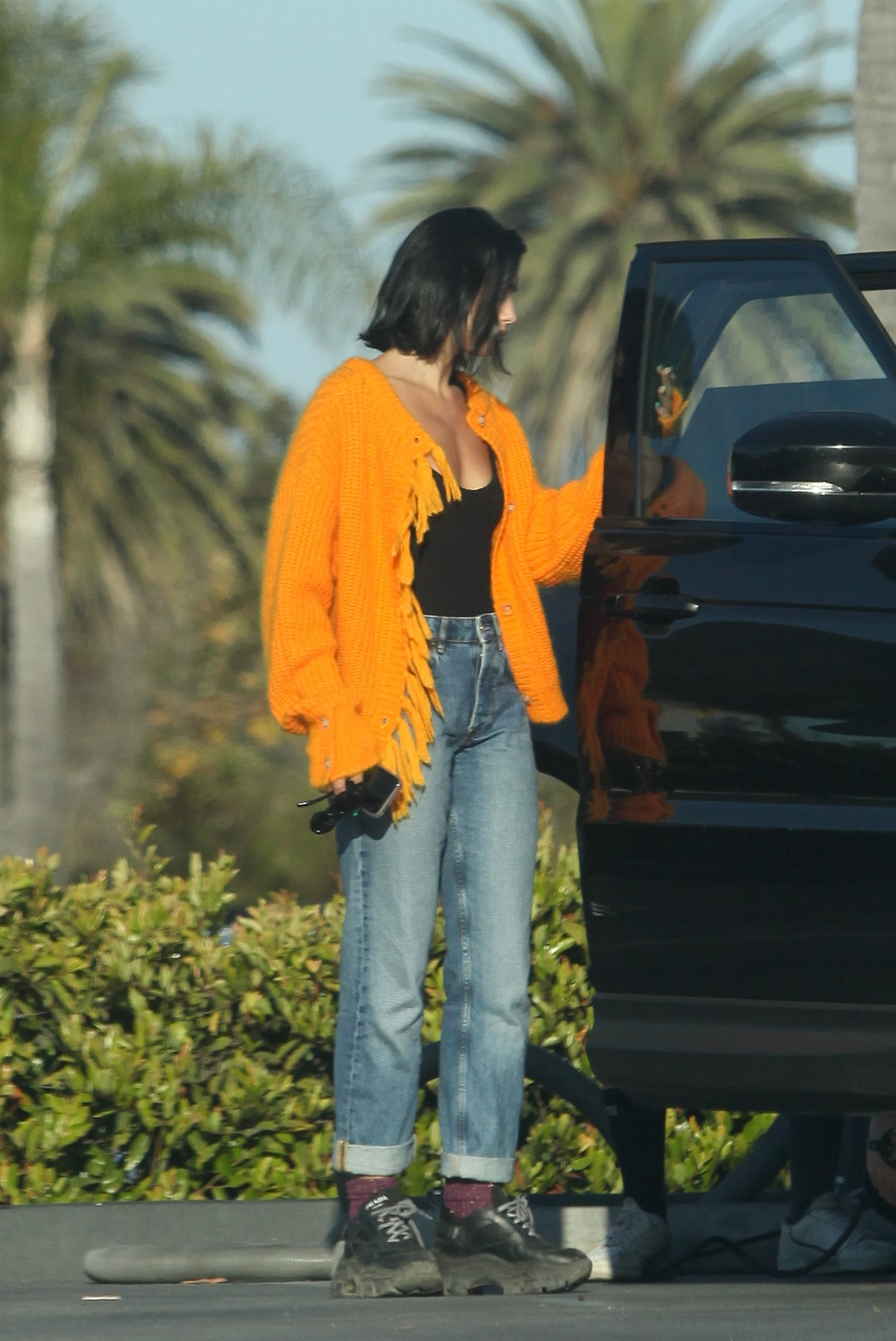 EXCLUSIVE: Dua Lipa and Anwar Hadid pulled over to a nearby gas station to put air in a flat tire ahead of the MTV VMA's. Dua supervised while her friend did the work and Anwar waited in the car. Dua was wearing a orange cardigan with a black tank top, folded boyfriend jeans and Prada Block Sneakers. 25 Aug 2019, Image: 467277379, License: Rights-managed, Restrictions: World Rights, Model Release: no, Credit line: MEGA / Mega Agency / Profimedia