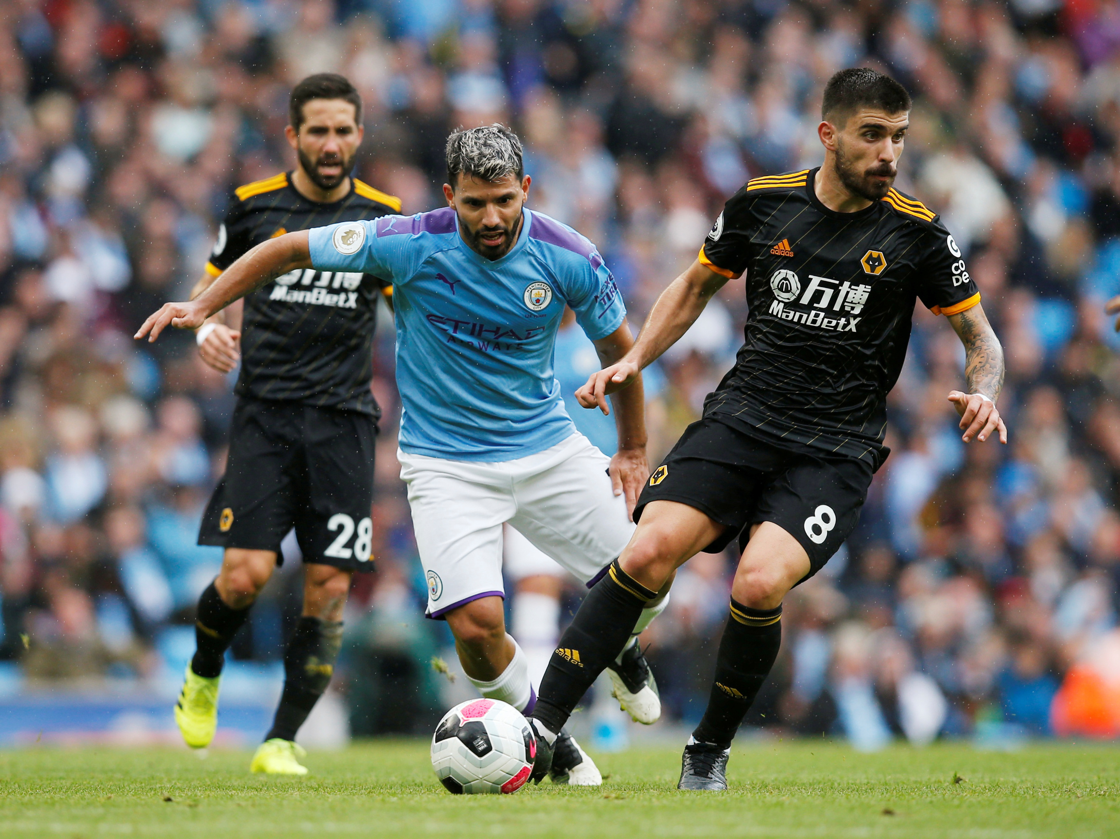 Soccer Football - Premier League - Manchester City v Wolverhampton Wanderers - Etihad Stadium, Manchester, Britain - October 6, 2019  Manchester City's Sergio Aguero in action with Wolverhampton Wanderers' Ruben Neves   REUTERS/Andrew Yates   EDITORIAL USE ONLY. No use with unauthorized audio, video, data, fixture lists, club/league logos or