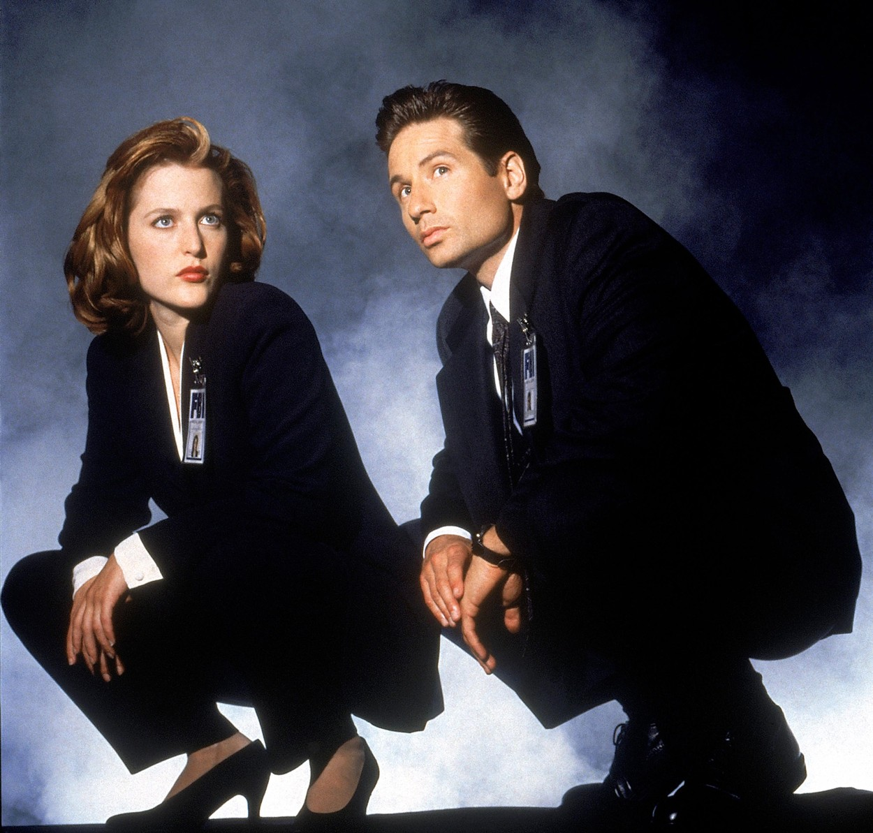 Gillian Anderson, David Duchovny (Fox Mulder) in TV serie THE X-FILES : created by Chris Carter (1993) starring Gillian Anderson, David Duchovny, Mitch Pileggi, Joel McHale; Fantastic; Fantastique; Science fiction; television; serie internationnal; american; candian; serie; TV; X-FILES : AUX FRONTIERES DU REEL; Fox Television; Agents FBI; Fox Mulder (David Duchovny); Dana Scully (Gillian Anderson); David Duchovny Filmography; actor; acteur; cinema; NOTE: this is a PR photo. Sunsetbox does not claim any Copyright or License in the attached material. Fees charged by Sunsetbox are for Sunsetbox's services only, and do not, nor are they intended to, convey to the user any ownership of Copyright or License in the material. By publishing this material, the user expressly agrees to indemnify and to hold Sunsetbox harmless from any claims, demands, or causes of action arising out of or connected in any way with user's publication of the material, Image: 271916570, License: Rights-managed, Restrictions: , Model Release: no, Credit line: Sunset Box / Allpix Press / Profimedia