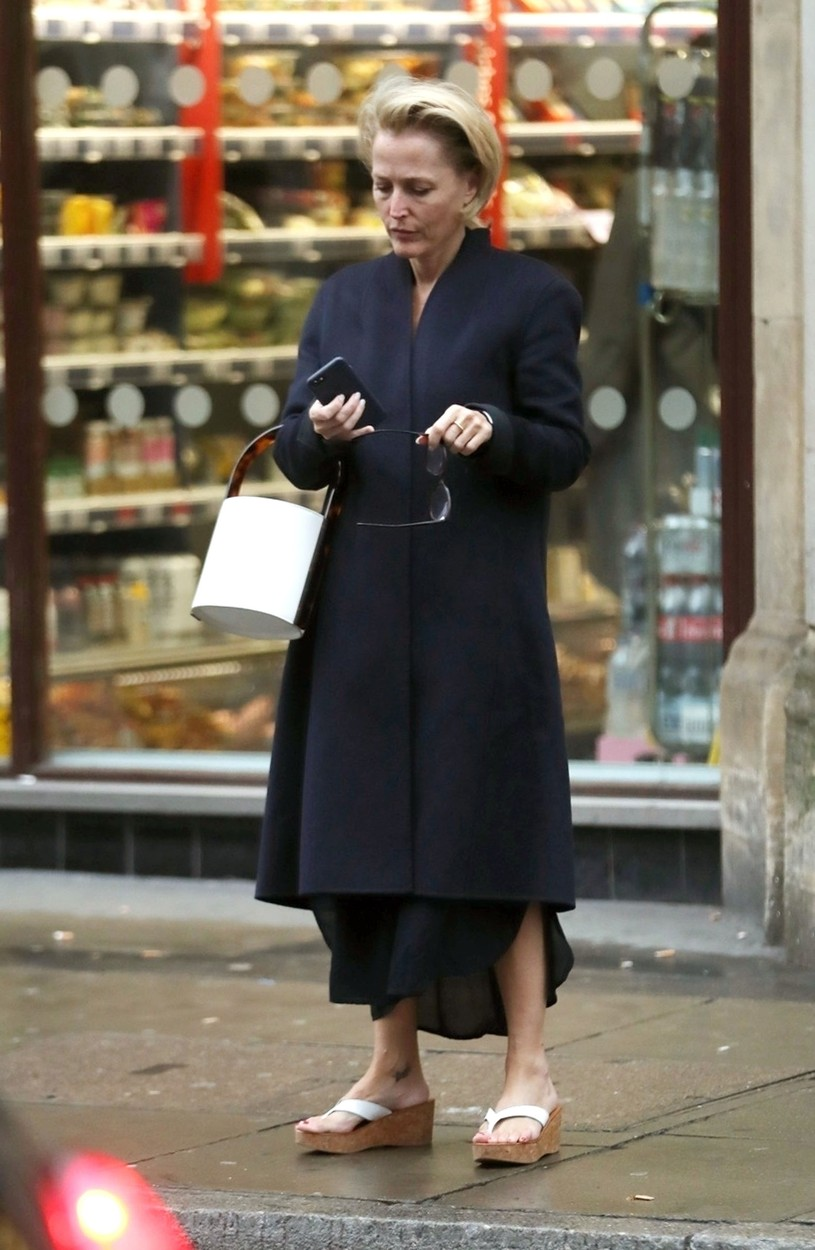 London, UNITED KINGDOM  - *EXCLUSIVE*  - Former X-Files star Gillian Anderson looks chic with her long blue coat on an autumnal day in the capital looking a little pre-occupied on her phone outside a Sainsbury's store in London.  *UK Clients - Pictures Containing Children Please Pixelate Face Prior To Publication*, Image: 475750921, License: Rights-managed, Restrictions: , Model Release: no, Credit line: BACKGRID / Backgrid UK / Profimedia