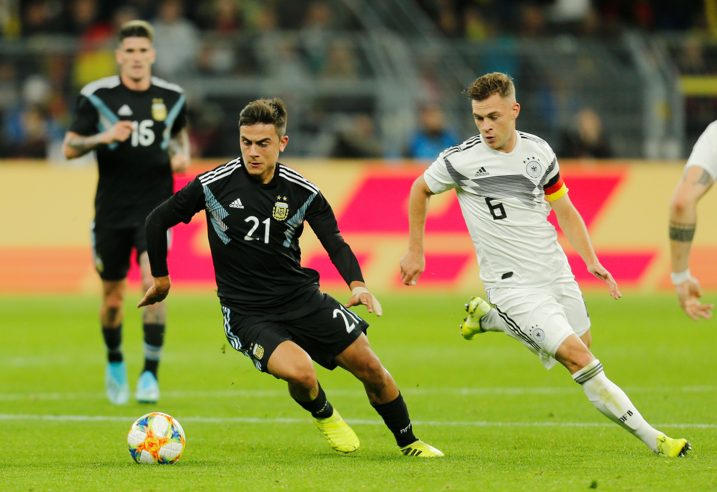 Soccer Football - International Friendly - Germany v Argentina - Signal Iduna Park, Dortmund, Germany - October 9, 2019   Argentina's Paulo Dybala in action with Germany's Joshua Kimmich    REUTERS/Leon Kuegeler      DFB regulations prohibit any use of photographs as image sequences and/or quasi-video - RC176FB278A0