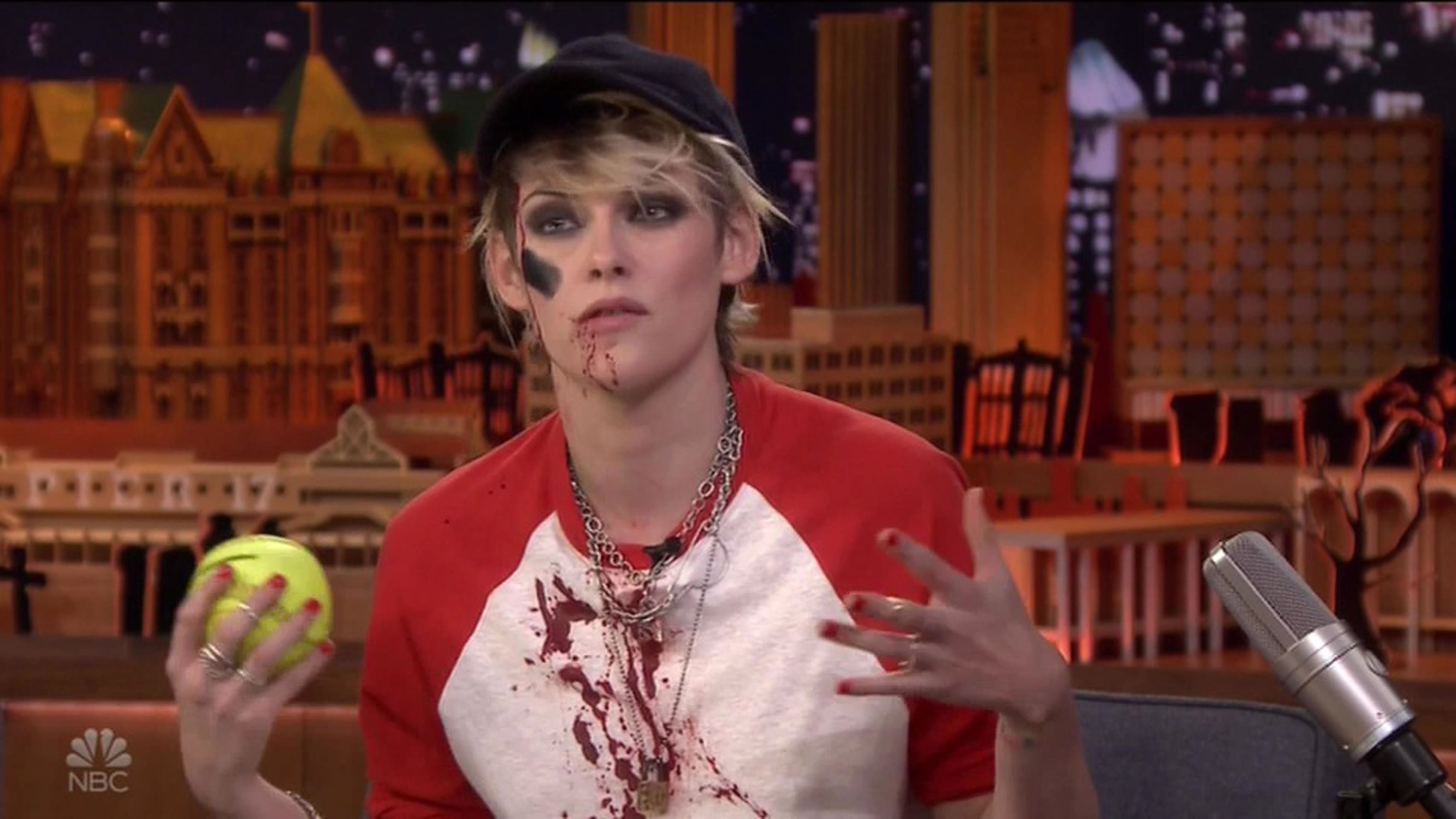 Los Angeles, CA  - Kristen Stewart dresses as a bloody baseball player but gives bizarre explanation of her costume as she appears on The Tonight Show. The Twilight star was on the show to promote her new Charlie's Angels movie - and came out on stage in a bloody baseball player costume complete with a bright yellow baseball. Host Jimmy Fallon told her: