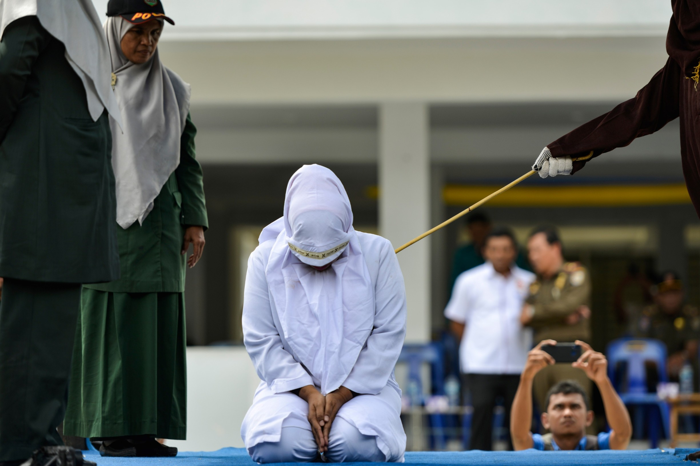 A woman is whipped in public by a member of the Sharia police in Banda Aceh on October 31, 2019, after being caught having an affair with Aceh Ulema Council (MPU) member Mukhlis. An Indonesian man working for an organisation which helped draft strict religious laws ordering adulterers to be flogged was himself publically whipped on October 31 after he was caught having an affair with a married woman., Image: 480105889, License: Rights-managed, Restrictions: , Model Release: no, Credit line: CHAIDEER MAHYUDDIN / AFP / Profimedia