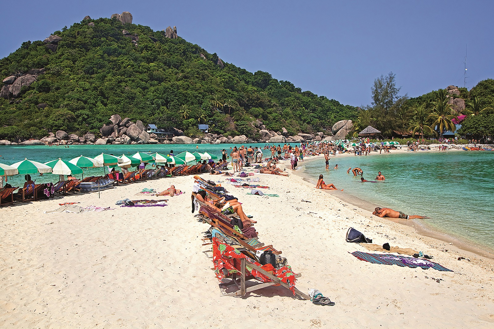 Western tourists sunbathing on beach of Ko Nang Yuan / Nangyuan, small island near Ko Tao along the Central Gulf Coast in Southern Thailand. (Photo by: Arterra/Universal Images Group via Getty Images)