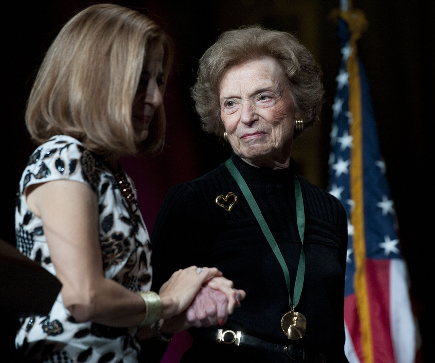 California first lady Anne Gust Brown (L) walks on the stage with Gap clothing store chain founder Doris Fisher after she was inducted along with her late husband Donald, during the 2011 California Hall of Fame Induction Ceremony in Sacramento, California December 8, 2011. Photo taken December 8, 2011. REUTERS/Hector Amezcua/Pool (UNITED STATES - Tags: ENTERTAINMENT BUSINESS) - GM1E7CA0CQC01