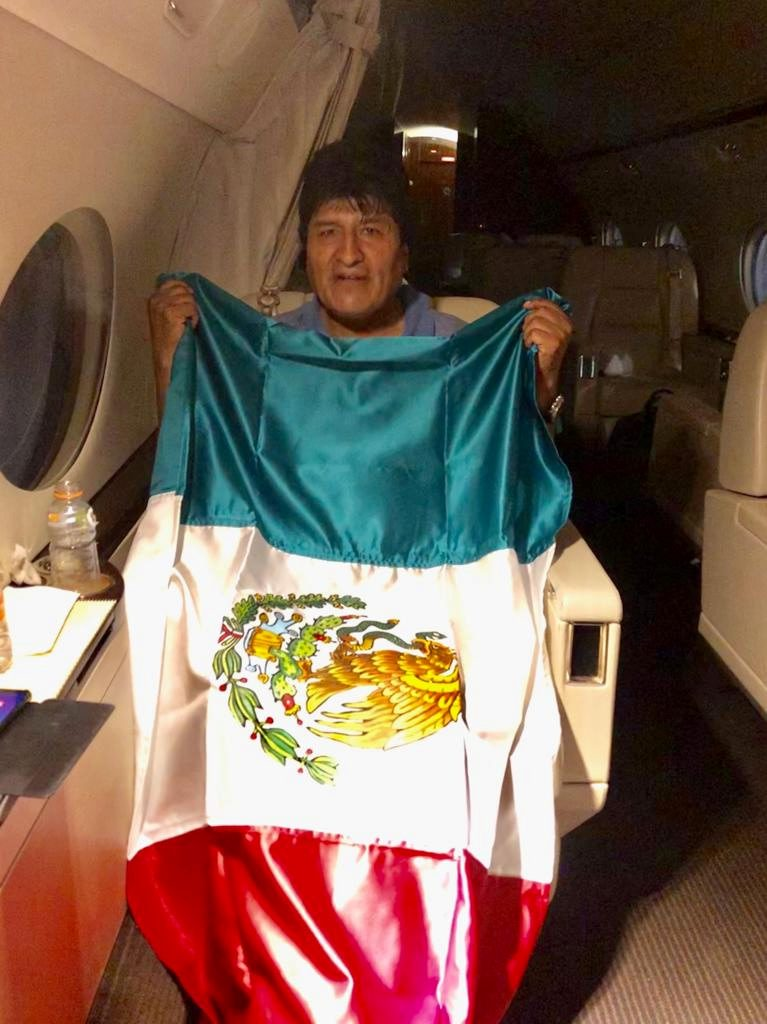 Former Bolivian President Evo Morales holds a Mexican flag onboard a Mexican government's aircraft in an unidentified location  November 11, 2019.   Mexican Foreign Minister Marcelo Ebrard via Twitter via REUTERS  ATTENTION EDITORS - THIS IMAGE HAS BEEN SUPPLIED BY A THIRD PARTY. MANDATORY CREDIT. NO RESALES. NO ARCHIVES.  TPX IMAGES OF THE DAY        REFILE - CORRECTING SOURCE.