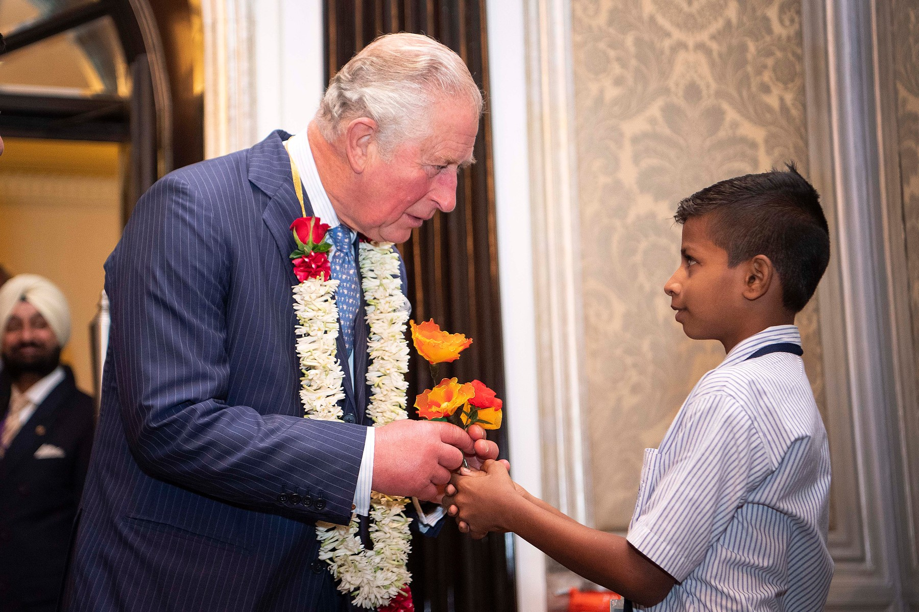 The Prince of Wales receives a flower and garland from a school boy during a British Asian Trust reception in Mumbai, on day two of the royal visit to India., Image: 482790909, License: Rights-managed, Restrictions: , Model Release: no, Credit line: Victoria Jones / PA Images / Profimedia
