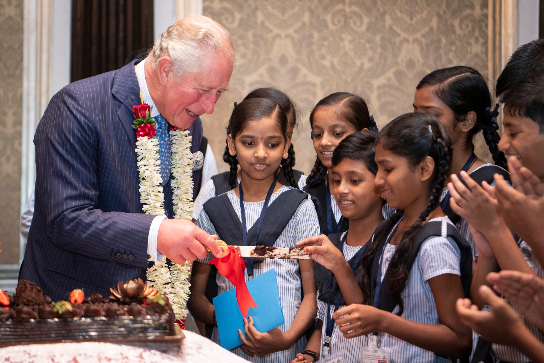 The Prince of Wales offers a piece of birthday cake to a school girl during a British Asian Trust reception in Mumbai, on day two of the royal visit to India., Image: 482790950, License: Rights-managed, Restrictions: , Model Release: no, Credit line: Victoria Jones / PA Images / Profimedia