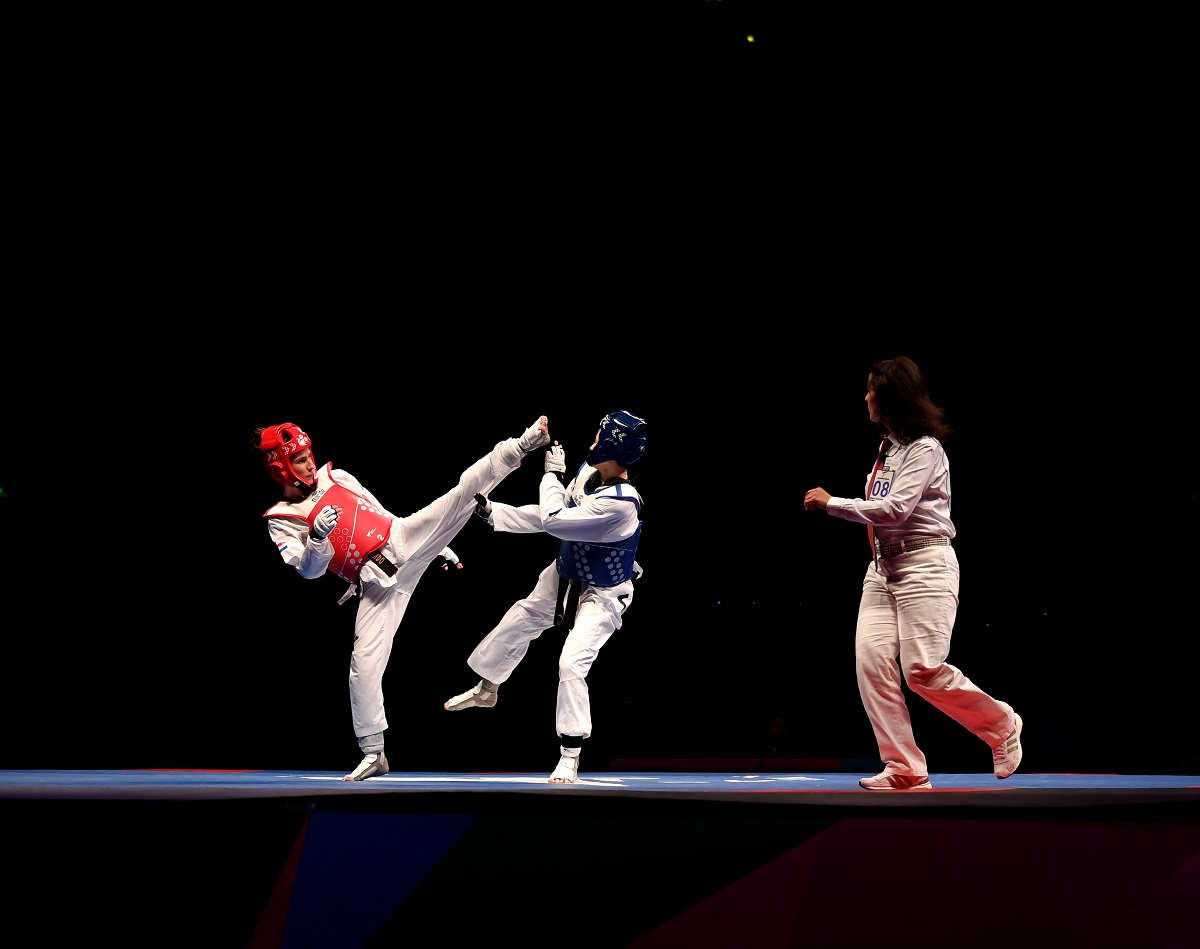 MANCHESTER, ENGLAND - MAY 17: Jingyu Wu of China competes against Kristina Tomic of Croatia in the Semi Final of the Women's -49kg during Day 3 of the World Taekwondo Championships at Manchester Arena on May 17, 2019 in Manchester, England. (Photo by Laurence Griffiths/Getty Images)