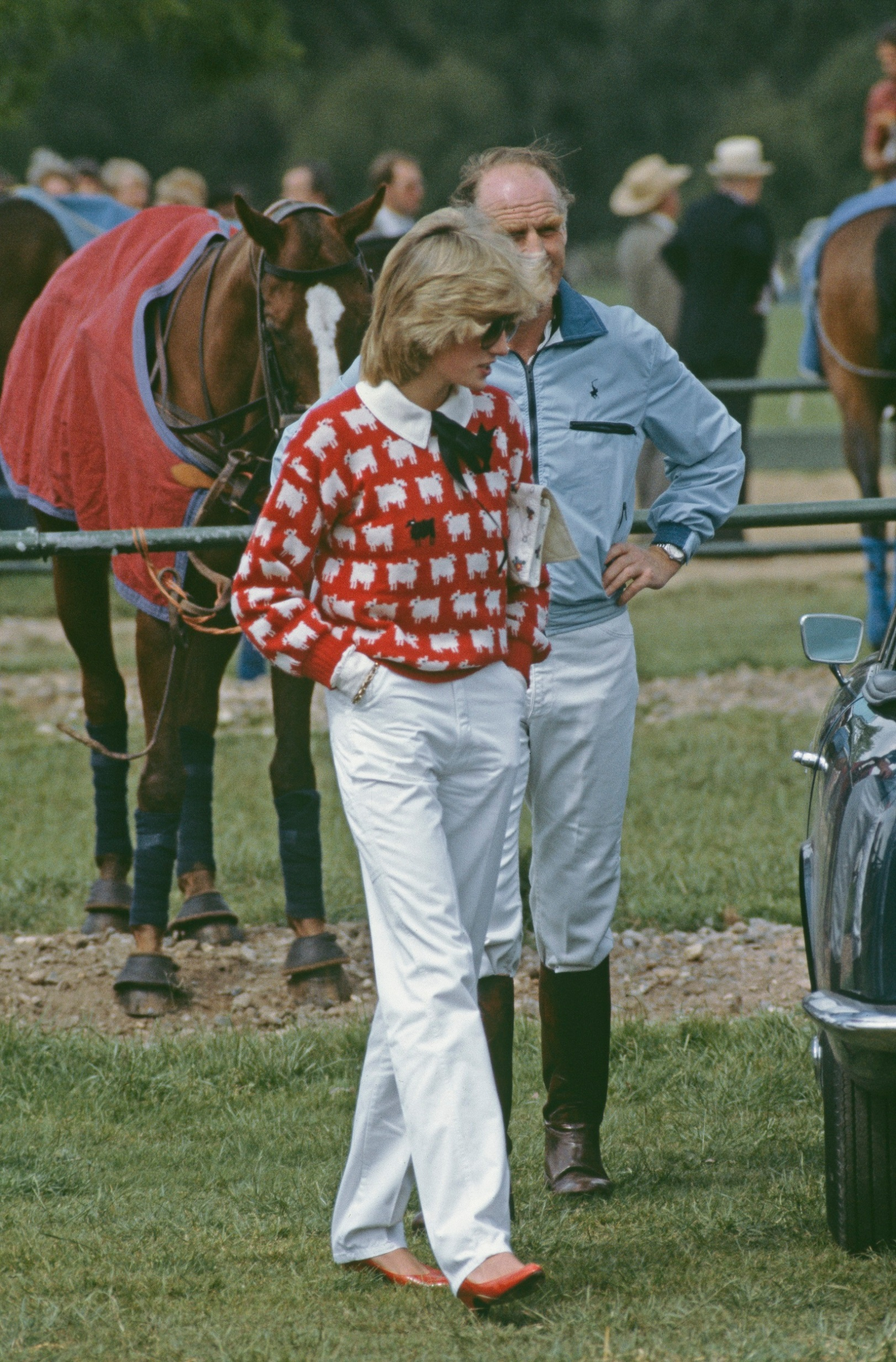 Diana, Princess of Wales  (1961 - 1997) with Major Ronald Ferguson (1931 - 2003) at a polo match at Smith's Lawn, Guards Polo Club, Windsor, June 1983. Diana is wearing a Muir and Osborne 'black sheep' sweater. (Photo by Princess Diana Archive/Getty Images)