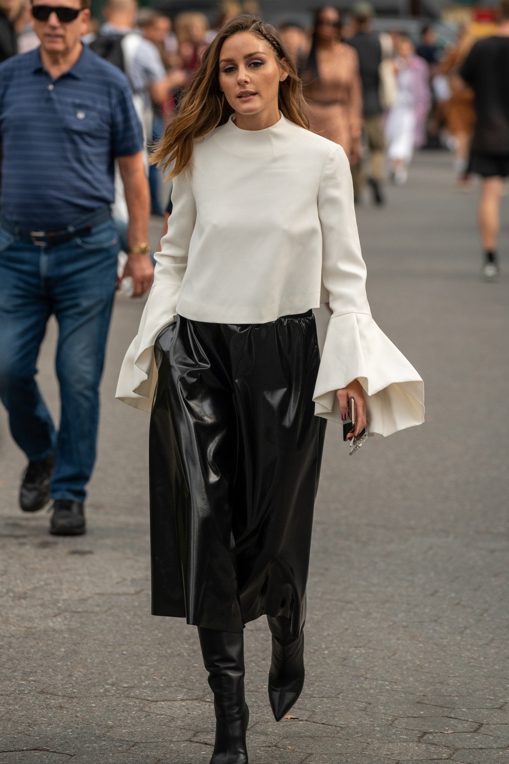 NEW YORK, NY - SEPTEMBER 09: Olivia Palermo is seen wearing a cream blouse, a black skirt, and black boots during New York Fashion Week at the Garden of the Battery on September 9, 2019 in New York City. (Photo by David Dee Delgado/Getty Images)