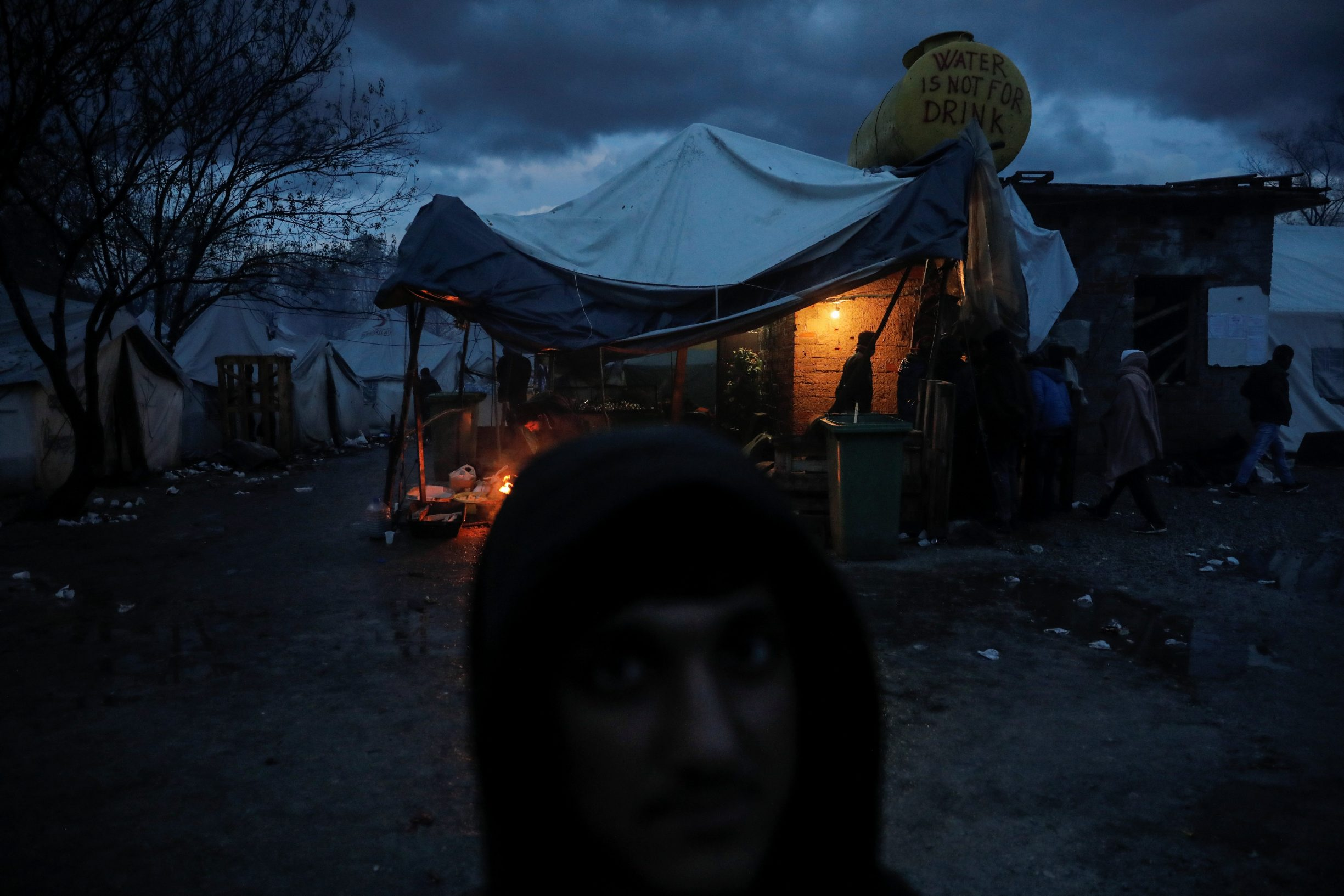 A migrant stands in front of the main tent inside Vucjak camp near Bihac, Bosnia and Herzegovina, November 13, 2019. Picture taken November 13, 2019. REUTERS/Marko Djurica