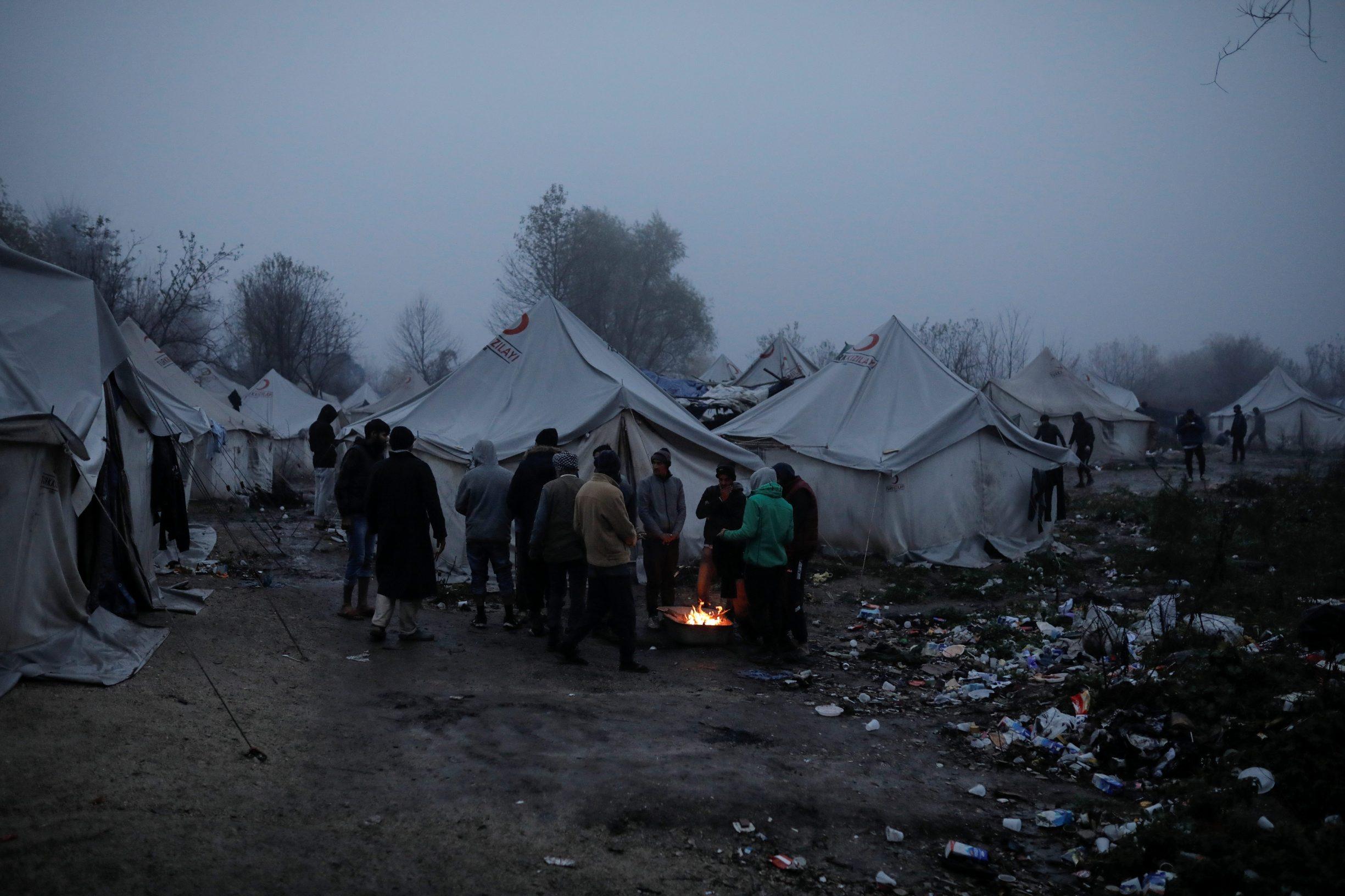 Migrants warm themselves by the fire inside Vucjak camp near Bihac, Bosnia and Herzegovina, November 14, 2019. REUTERS/Marko Djurica