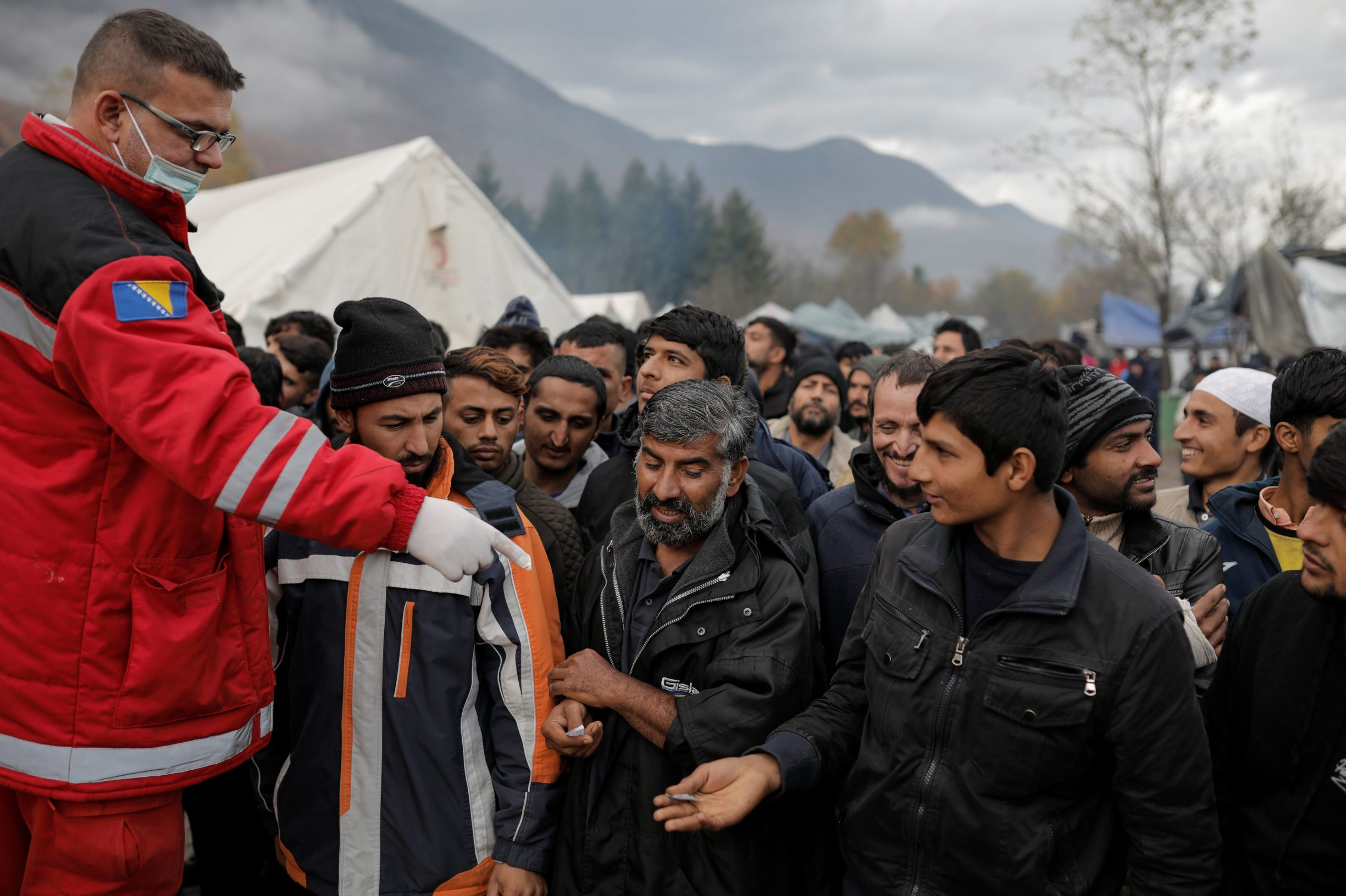 Migrants queue for free shoes delivery inside Vucjak camp near Bihac, Bosnia and Herzegovina, November 15, 2019. REUTERS/Marko Djurica