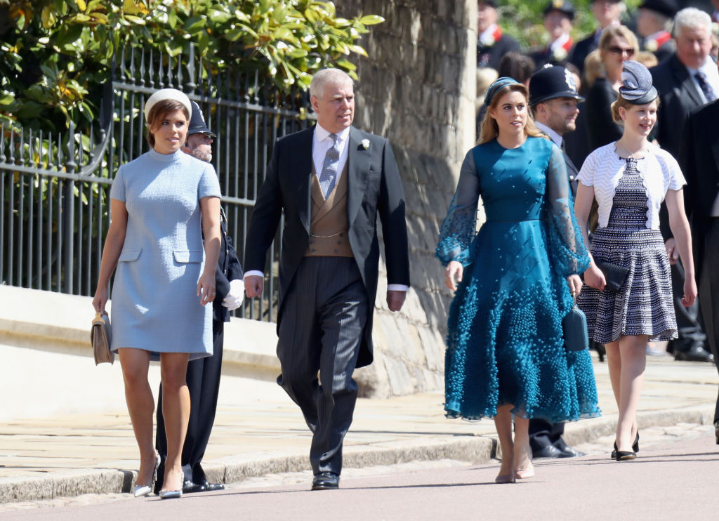 WINDSOR, ENGLAND - MAY 19:  (L-R) Princess Eugenie, Prince Andrew, Duke of York and Princess Beatrice attend the wedding of Prince Harry to Ms Meghan Markle at St George's Chapel, Windsor Castle on May 19, 2018 in Windsor, England. Prince Henry Charles Albert David of Wales marries Ms. Meghan Markle in a service at St George's Chapel inside the grounds of Windsor Castle. Among the guests were 2200 members of the public, the royal family and Ms. Markle's Mother Doria Ragland.  (Photo by Chris Jackson/Getty Images)