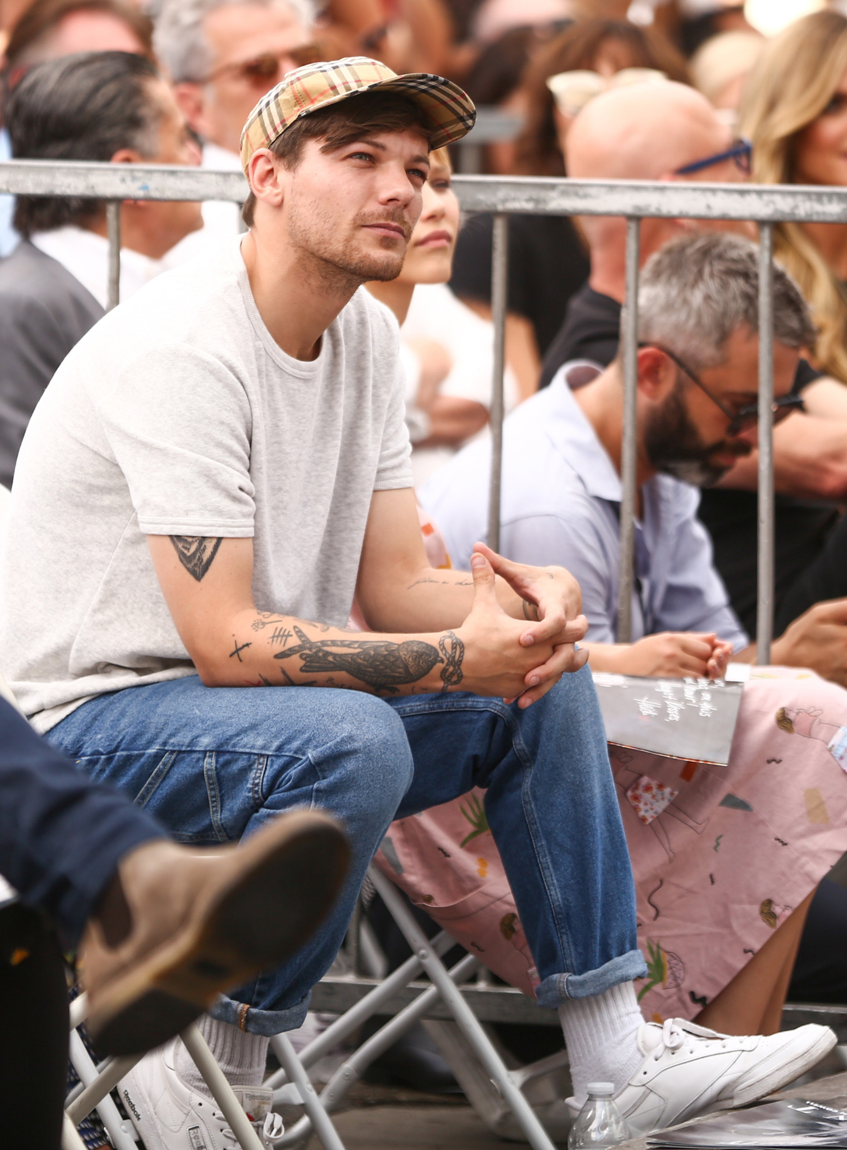HOLLYWOOD, CA - AUGUST 22:  Louis Tomlinson attends a ceremony honoring Simon Cowell with a star on the Hollywood Walk of Fame on August 22, 2018 in Hollywood, California.  (Photo by Rich Fury/Getty Images)