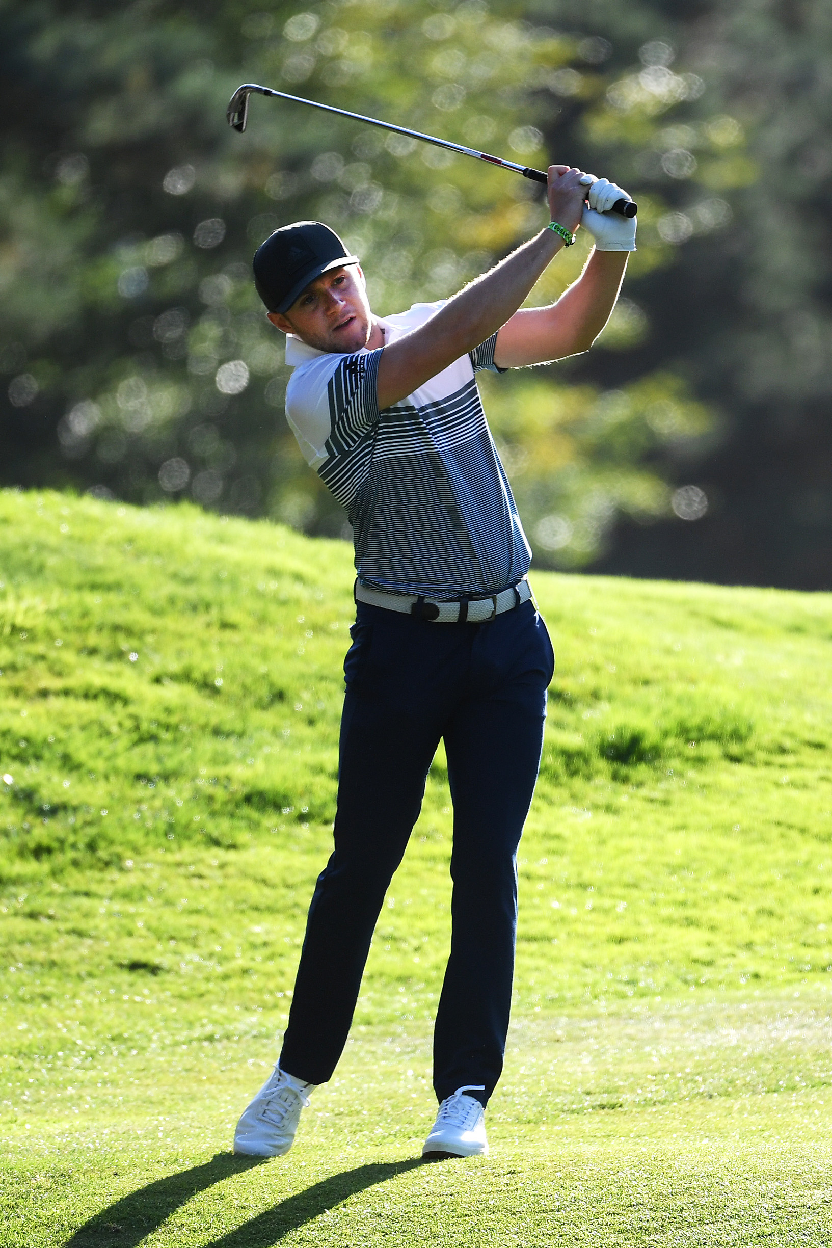 VIRGINIA WATER, ENGLAND - SEPTEMBER 18: Niall Horan plays a shot during the Pro-Am tournament prior to the start of the BMW PGA Championship at Wentworth Golf Club on September 18, 2019 in Virginia Water, United Kingdom. (Photo by Ross Kinnaird/Getty Images)
