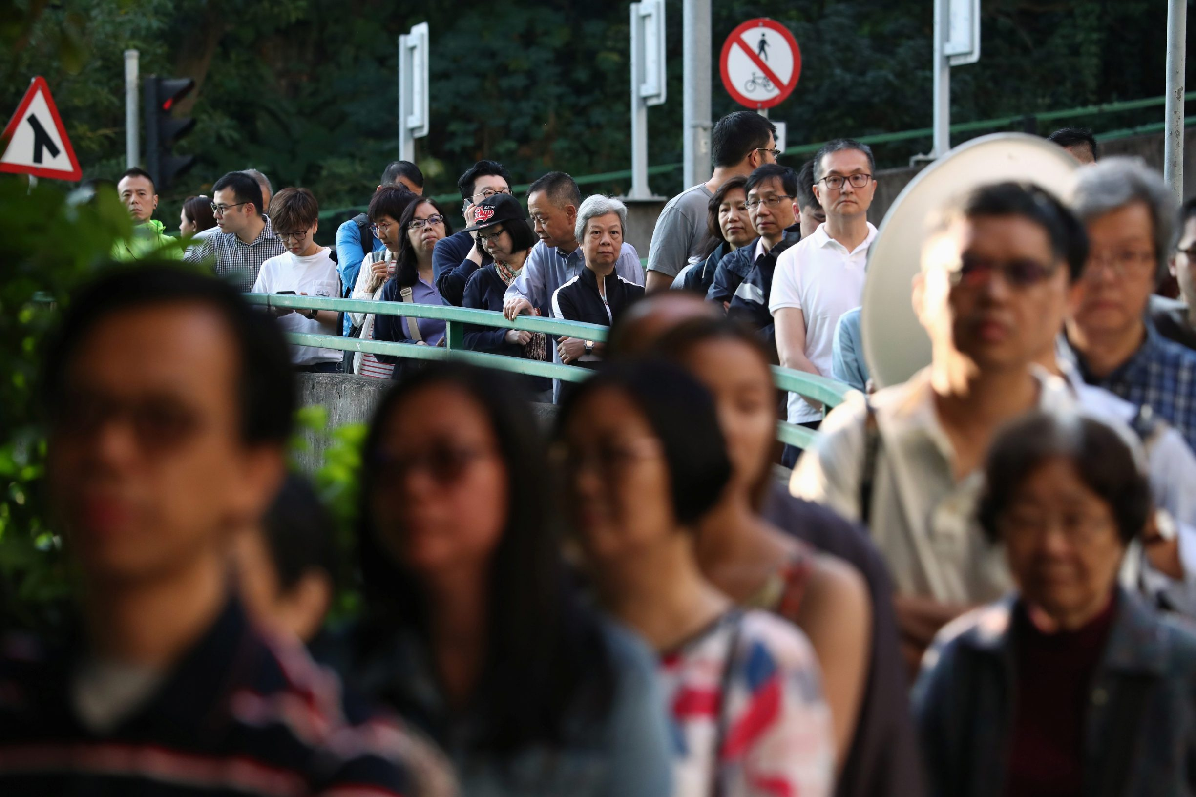 Voters line up at a polling station during district council local elections in Hong Kong, China November 24, 2019. REUTERS/Athit Perawongmetha