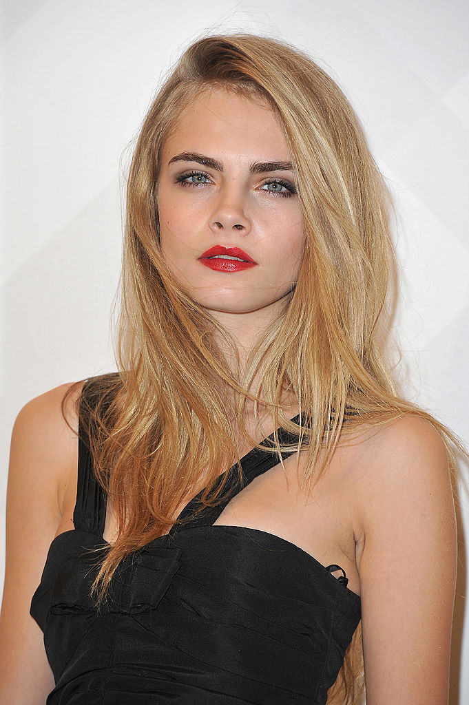 PARIS, FRANCE - DECEMBER 01:  Cara Delevingne attends the Burberry Paris Boutique Opening At British Embassy on December 1, 2011 in Paris, France.  (Photo by Pascal Le Segretain/Getty Images)