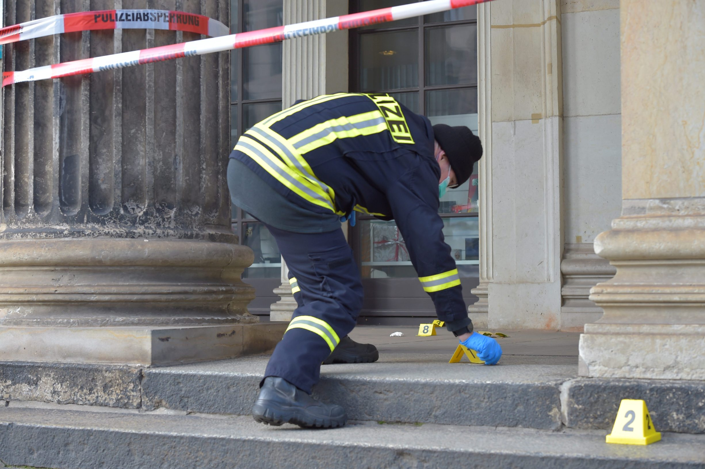 A policeman checks for evidence outside the Green Vault city palace, unique historic museum that contains the largest collection of treasures in Europe after a robbery in Dresden, Germany, November 25, 2019. REUTERS/Matthias Rietschel