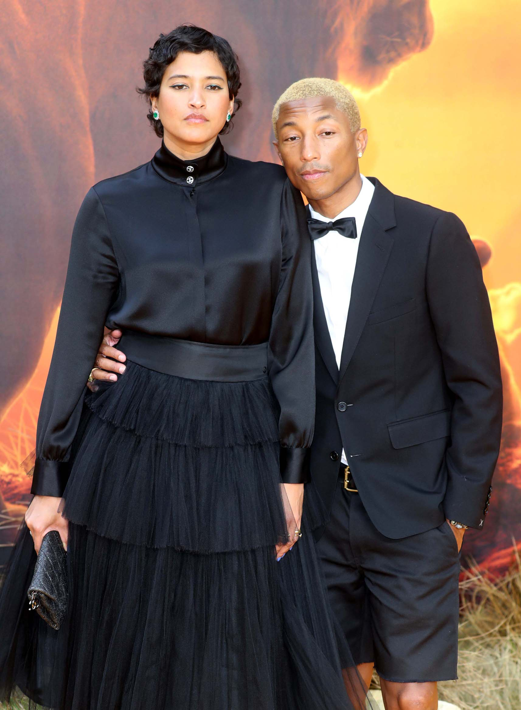 LONDON, ENGLAND - JULY 14:  Helen Lasichanh and Pharrell Williams attend