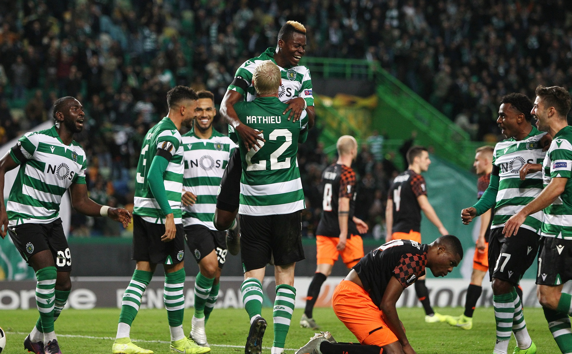 Soccer Football - Europa League - Group D - Sporting CP v PSV Eindhoven - Estadio Jose Alvalade, Lisbon, Portugal - November 28, 2019  Sporting's Jeremy Mathieu celebrates scoring their third goal with teammates       REUTERS/Pedro Nunes