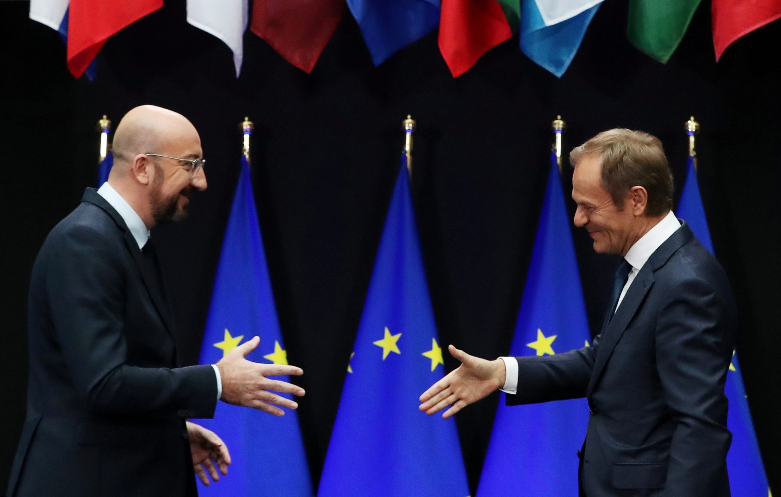 Incoming European Council President Charles Michel and outgoing European Council President Donald Tusk attend a handover ceremony in Brussels, Belgium November 29, 2019. REUTERS/Yves Herman     TPX IMAGES OF THE DAY