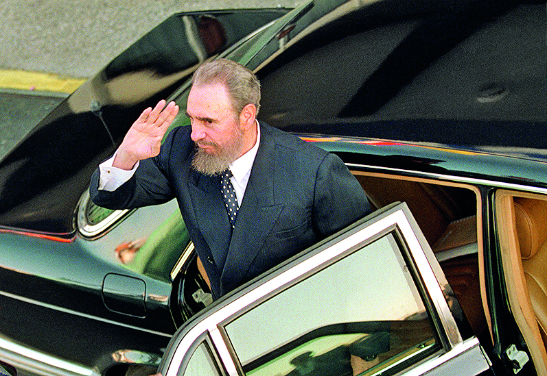 HAVANA, CUBA - JANUARY 21:  Fidel Castro salutes as he gets out of his Mercedes shortly before the arrival of Pope John Paul II at the Jose Marti Airport in Havana, Cuba January  21, 1998.  This was the first time Castro wore a suit for the first time in Cuba.  (Photo by Sven Creutzmann/Mambo Photography/Getty Images)