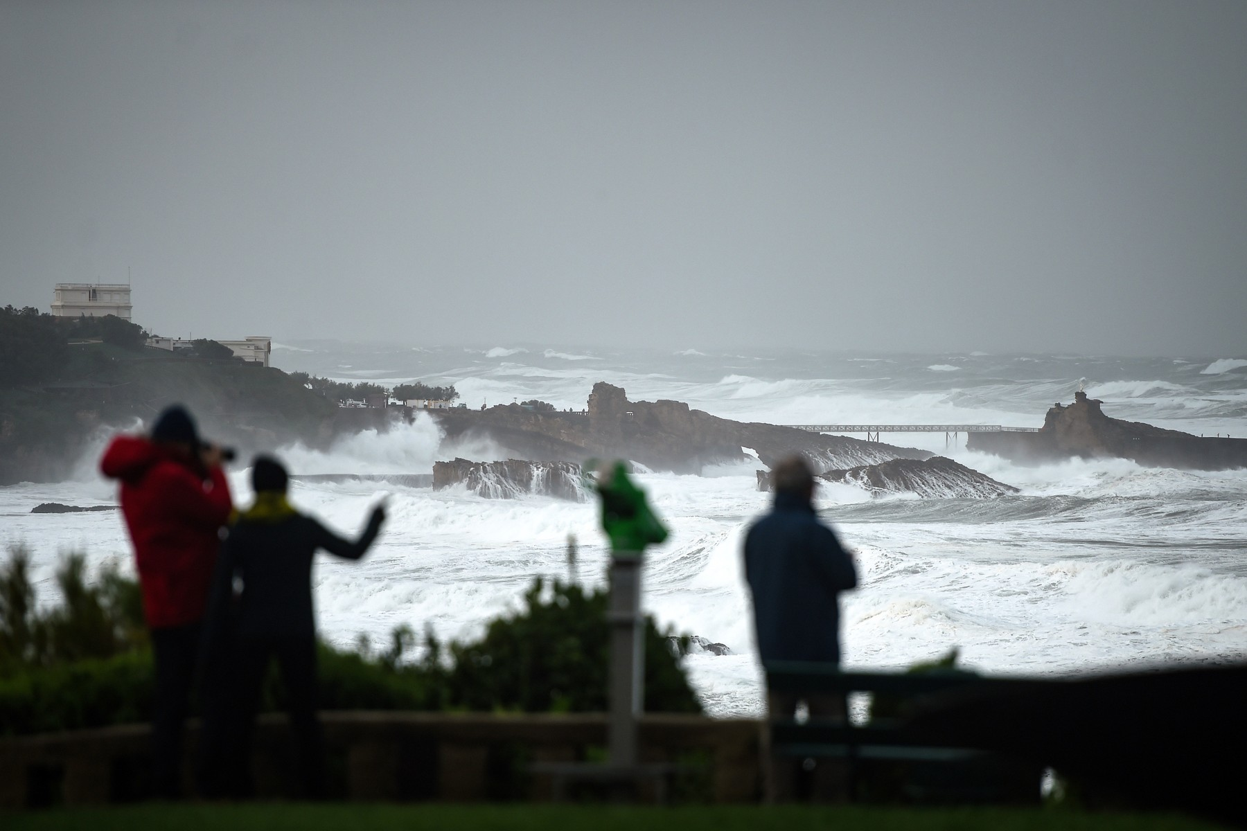 People look at the ocean's waves hitting the coast in Biarritz, south western France, on November 3, 2019 during the Amelie storm.  Some 100,000 households were deprived of electricity on the morning of November 3, 2019 in south western France, where the Atlantic coast was swept by storm Amelie, causing damage but no casualties, according to an initial assessment by the emergency services and the prefectures., Image: 480830838, License: Rights-managed, Restrictions: , Model Release: no, Credit line: GAIZKA IROZ / AFP / Profimedia