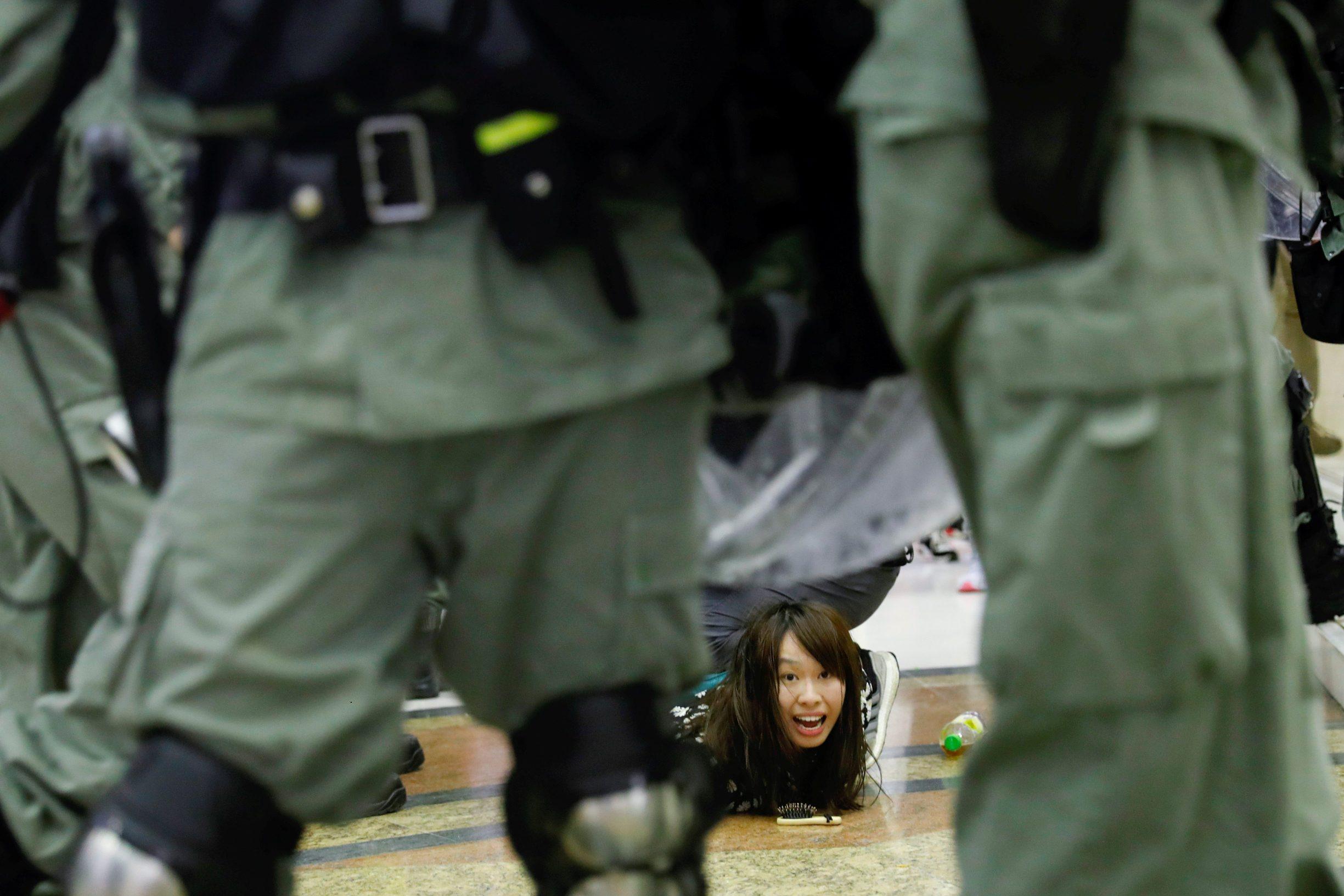 Riot police detain an anti-government protester at a shopping mall in Tai Po, Hong Kong , China November 3, 2019. REUTERS/Tyrone Siu