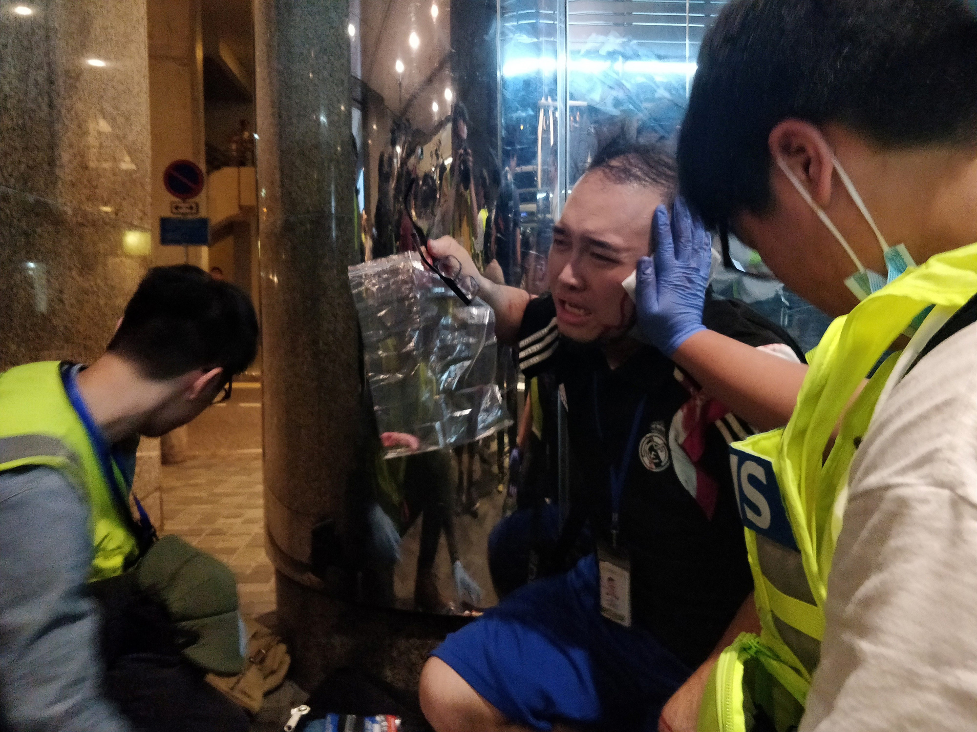 Andrew Chiu Ka Yin, District Councillor of Taikoo Shing West, receives help from first aid volunteers after sustaining an injury in a knife attack at a shopping mall, in Taikoo Shing in Hong Kong, China November 3, 2019. REUTERS/Stringer TAIWAN OUT. NO COMMERCIAL OR EDITORIAL SALES IN TAIWAN, HONG KONG OUT. NO COMMERCIAL OR EDITORIAL SALES IN HONG KONG. NO RESALES. NO ARCHIVES