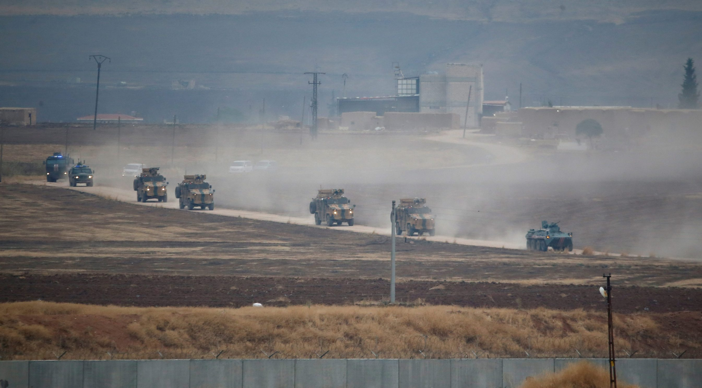 Turkish and Russian military vehicles return following a joint patrol in northeast Syria, as they are pictured from near the Turkish border town of Kiziltepe in Mardin province, Turkey, November 1, 2019. REUTERS/Kemal Aslan