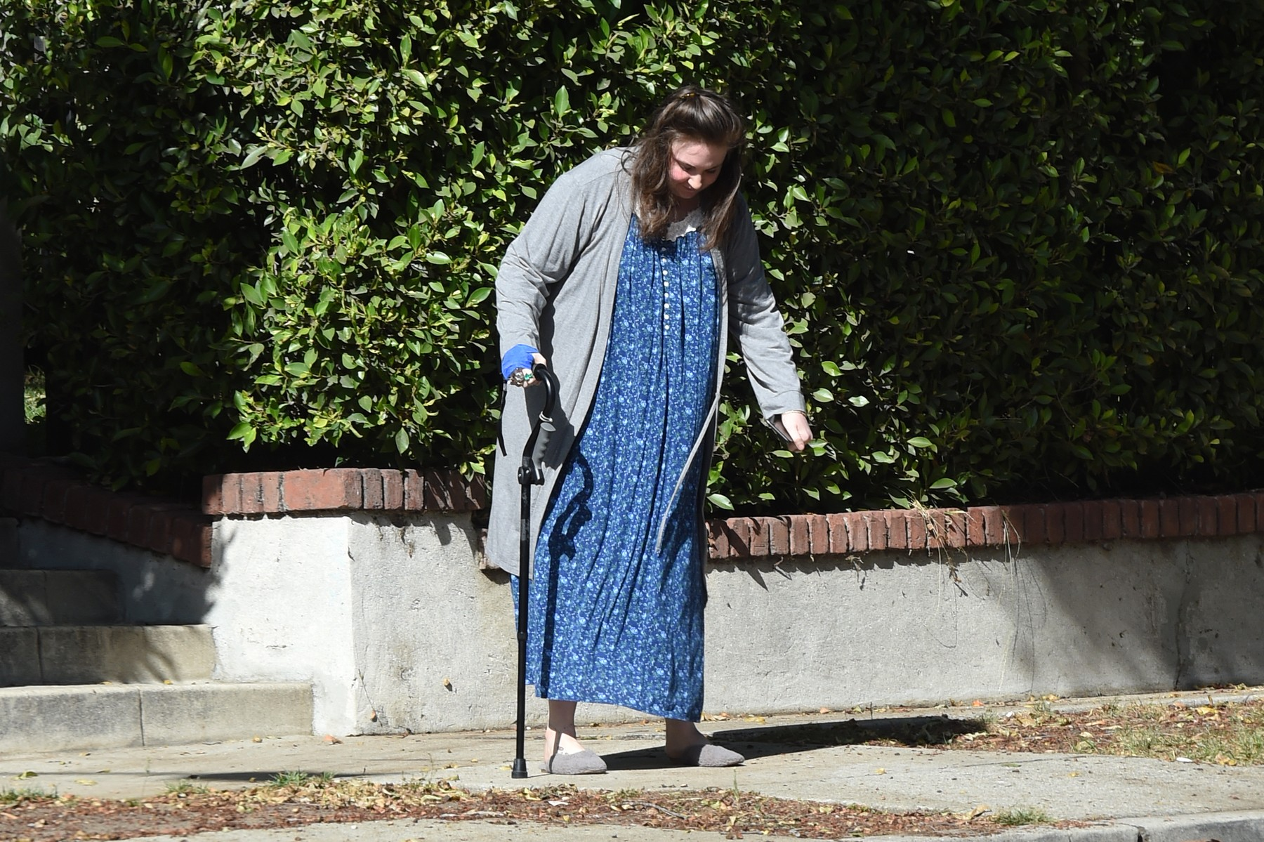 10/31/2019 EXCLUSIVE: Lena Dunham holds a cane with an apparently bandaged hand as she gingerly step out in Los Angeles. The 33 year old actress is wearing grey slippers, a long grey jacket and a blue nightgown., Image: 480194941, License: Rights-managed, Restrictions: Exclusive NO usage without agreed price and terms. Please contact sales@theimagedirect.com, Model Release: no, Credit line: TheImageDirect.com / The Image Direct / Profimedia
