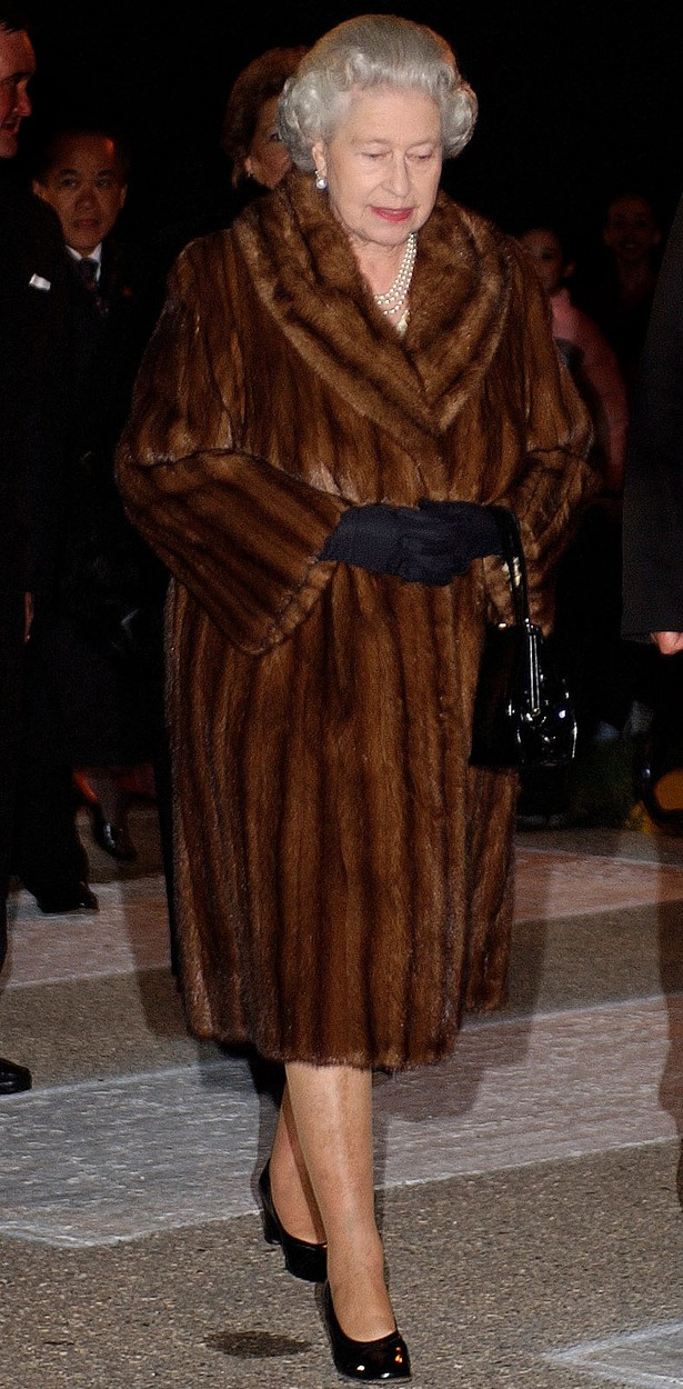 File photo dated 09/10/02 of Queen Elizabeth II wearing a fur coat as she enters the Legislative Assembly building in Winnipeg, Manitoba, during her two week Royal Golden Jubilee visit to Canada. The Queen no longer uses fur in her outfits, having switched to fake fur this year, her senior dresser has revealed., Image: 481186873, License: Rights-managed, Restrictions: FILE PHOTO, Model Release: no, Credit line: Kirsty Wigglesworth / PA Images / Profimedia