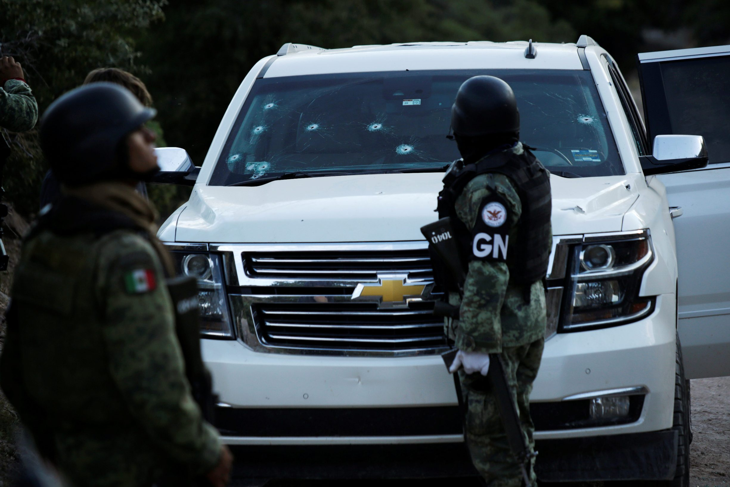 Soldiers assigned to Mexico's National Guard stand by a bullet-riddled vehicle belonging to one of the Mexican-American Mormon families that were killed by unknown assailants, in Bavispe, Sonora state, Mexico November 5, 2019. REUTERS/Jose Luis Gonzalez