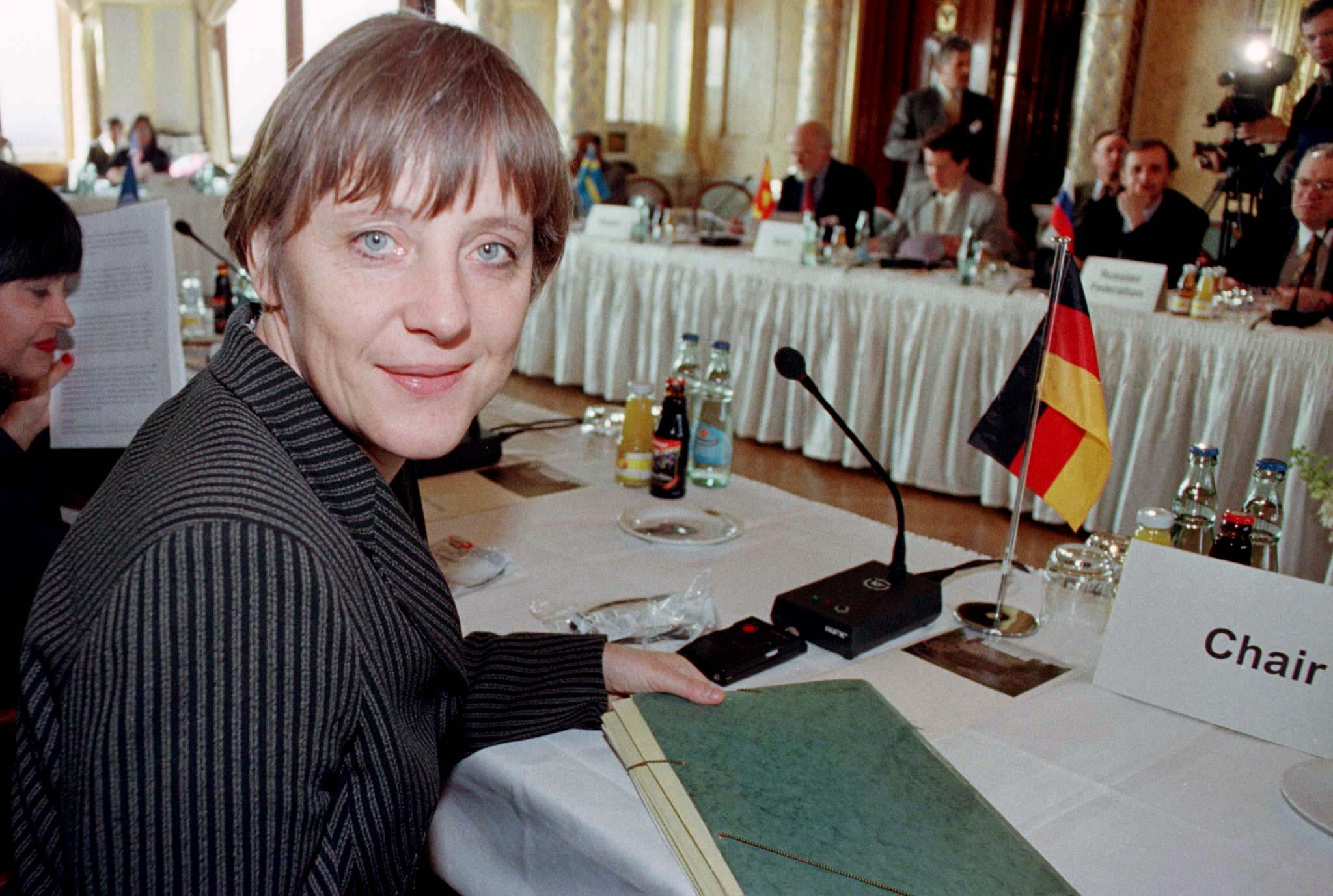 German Environment Minister Angela Merkel smiles prior to a environmental ministers conference at Albrechtsburg castle in Dresden, March 23. Ministers from 21 countries will attend the annual conference to discuss environmental issues.  GERMANY - RP1DRICZETAC