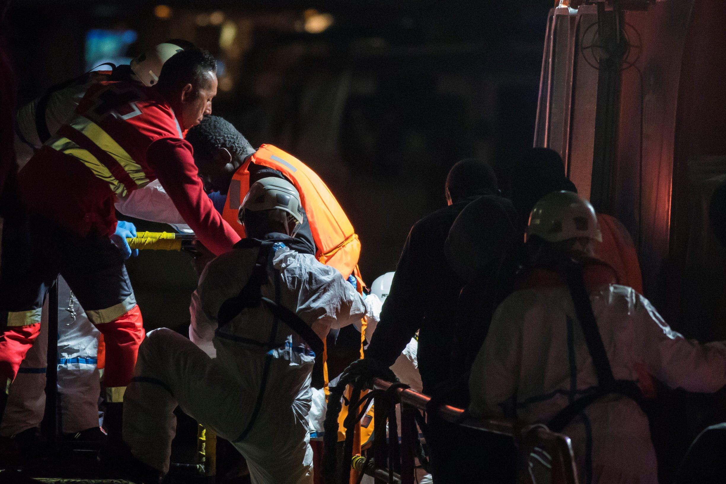 Migrants arrive aboard a Spanish maritime rescue boat