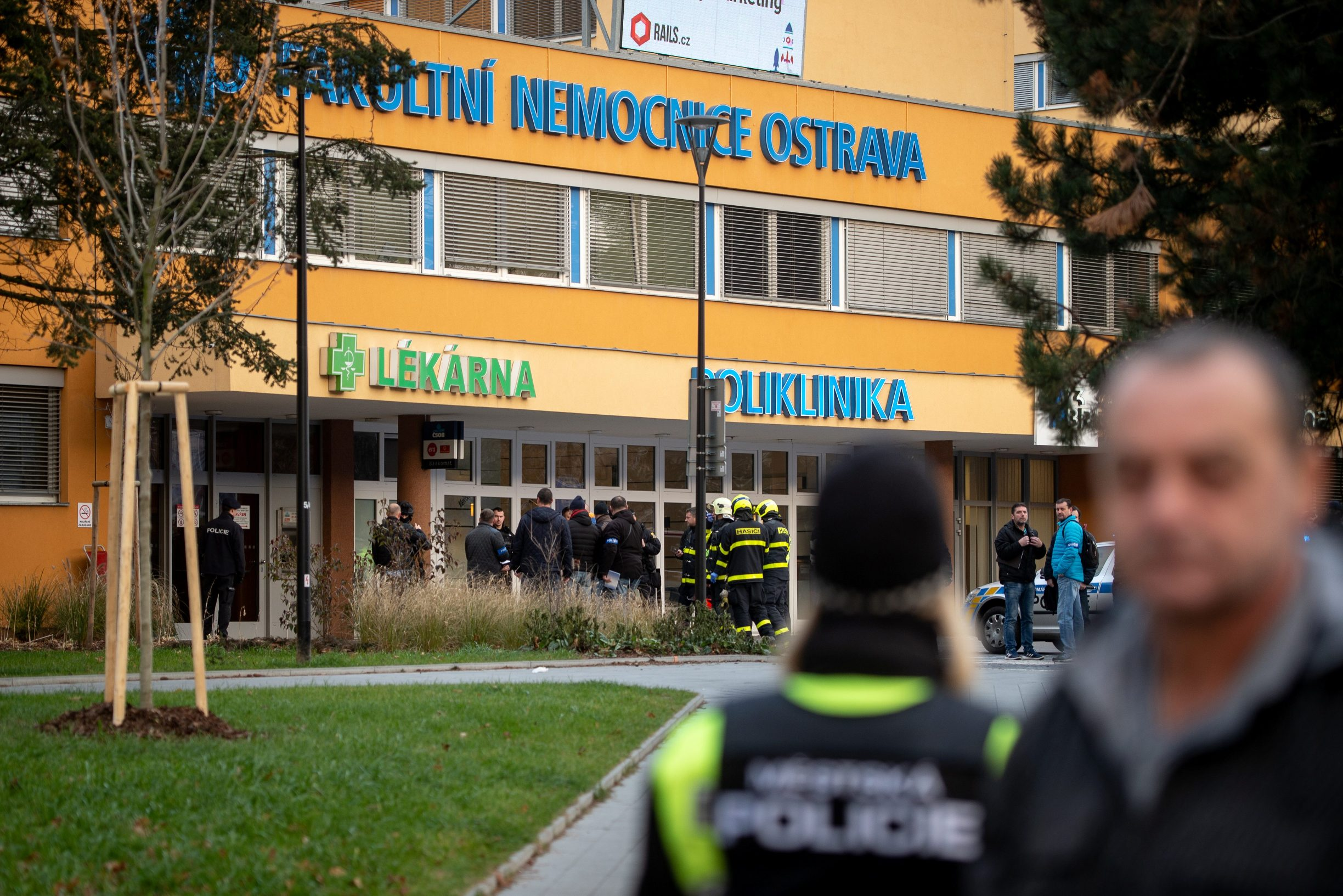 Police officers stand guard near the site of a shooting in front of a hospital in Ostrava, Czech Republic, December 10, 2019.   REUTERS/Lukas Kabon
