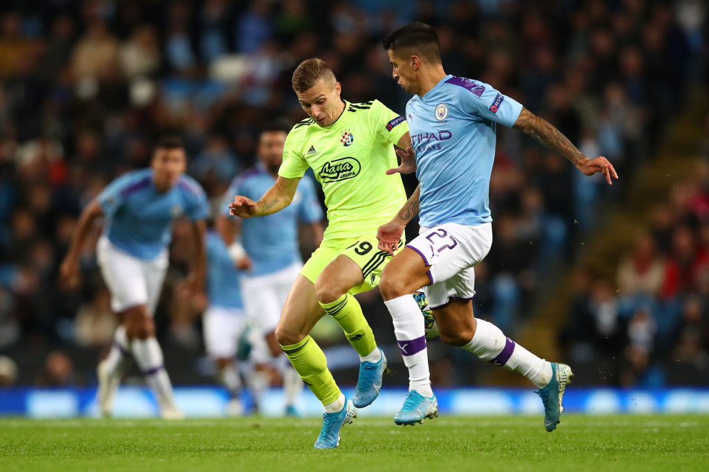 MANCHESTER, ENGLAND - OCTOBER 01: Joao Cancelo of Manchester City is challenged by Mislav Orsic of GNK Dinamo Zagreb during the UEFA Champions League group C match between Manchester City and Dinamo Zagreb at Etihad Stadium on October 01, 2019 in Manchester, United Kingdom. (Photo by Clive Brunskill/Getty Images)