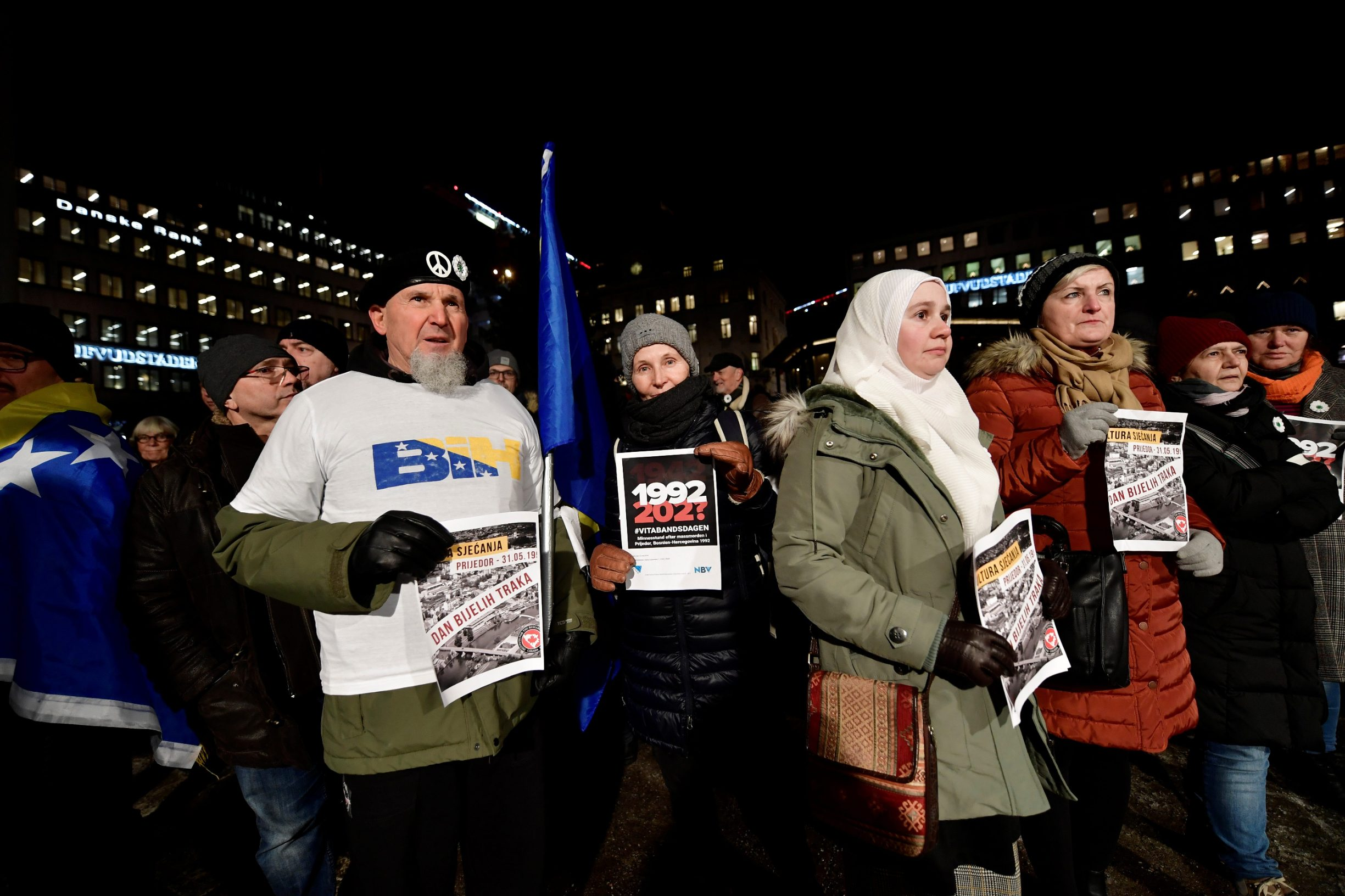 Protesters hold posters at a demonstration against the awarding of the 2019 Nobel literature prize to Peter Handke in Stockholm, Sweden December 10, 2019. TT News Agency/Stina Stjernkvist via REUTERS    THIS IMAGE HAS BEEN SUPPLIED BY A THIRD PARTY. SWEDEN OUT. NO COMMERCIAL OR EDITORIAL SALES IN SWEDEN