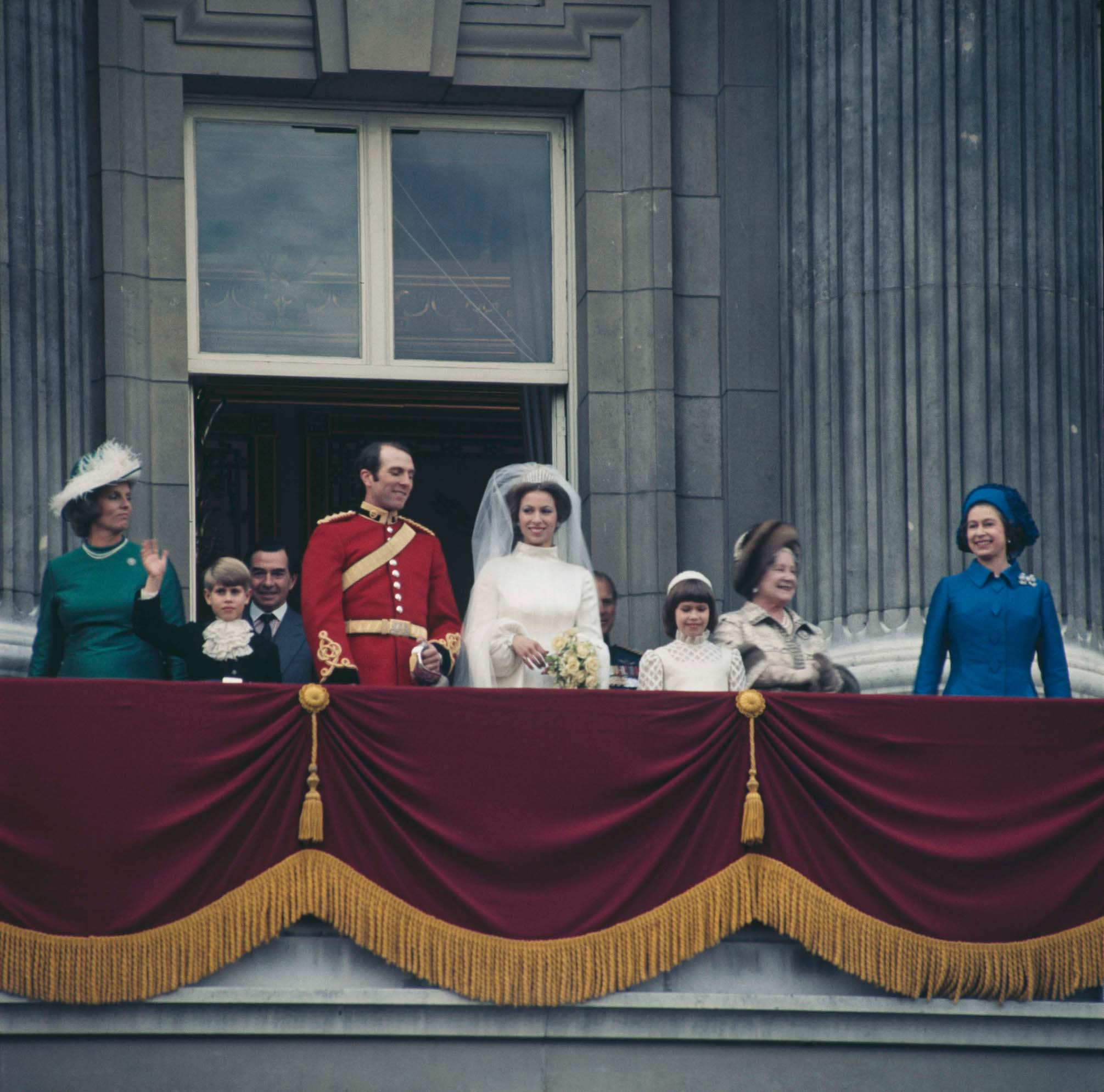 Anne, the Princess Royal and Mark Phillips pose on the balcony of Buckingham Palace in London, UK, after their wedding, 14th November 1973. Also pictured are Queen Elizabeth II and the Queen Mother.  (Photo by Fox Photos/Hulton Archive/Getty Images)