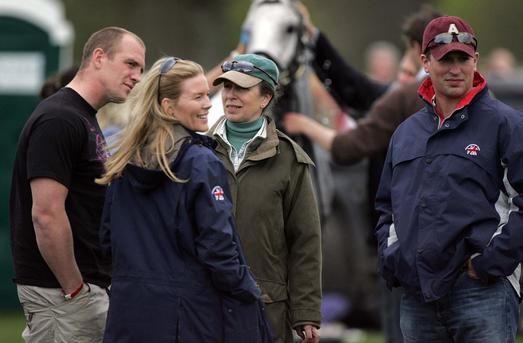 CHIPPING SODBURY, UNITED KINGDOM - MAY 03:  Zara Phillips' boyfriend, England and Gloucester rugby player, Mike Tindall chats with (L-R) Autumn Kelly, Princess Anne and Peter Phillips chat following the cross country during the Badminton Horse Trials on May 3 2008 in Badminton, England. Reigning world champion Zara Phillips is riding Glenbuck and Ardfield Magic Star at the world's largest three-day event as the British equestrian team look to finalise their 2008 Olympic squad. The event started with two days of dressage moving into cross country before finishing with showjumping tomorrow.  (Photo by Matt Cardy/Getty Images)