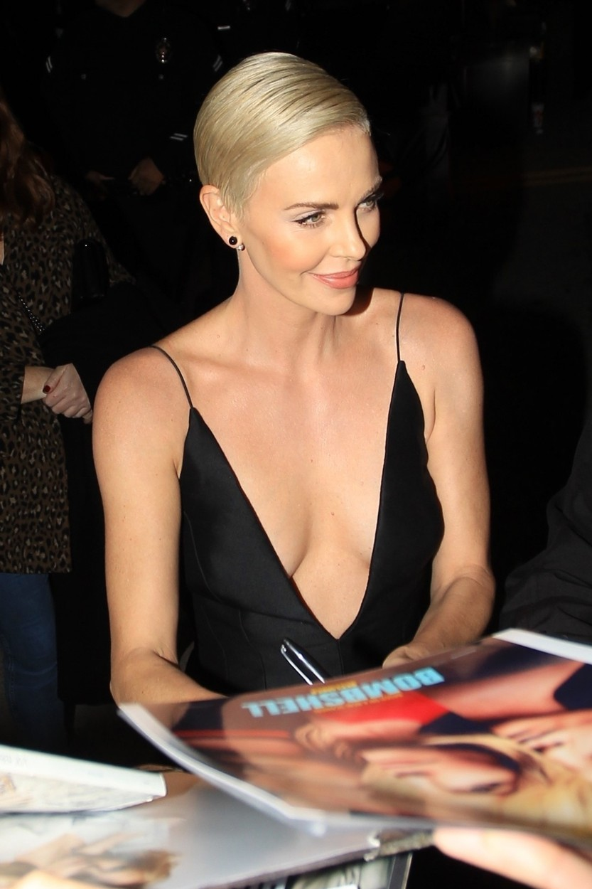 Los Angeles, CA  - Charlize Theron greets fans in a plunging black dress at the Special Screening of 'Bombshell' at the Regency Village in Los Angeles, California.  BACKGRID USA 10 DECEMBER 2019, Image: 487434180, License: Rights-managed, Restrictions: , Model Release: no, Credit line: BACKGRID / Backgrid USA / Profimedia