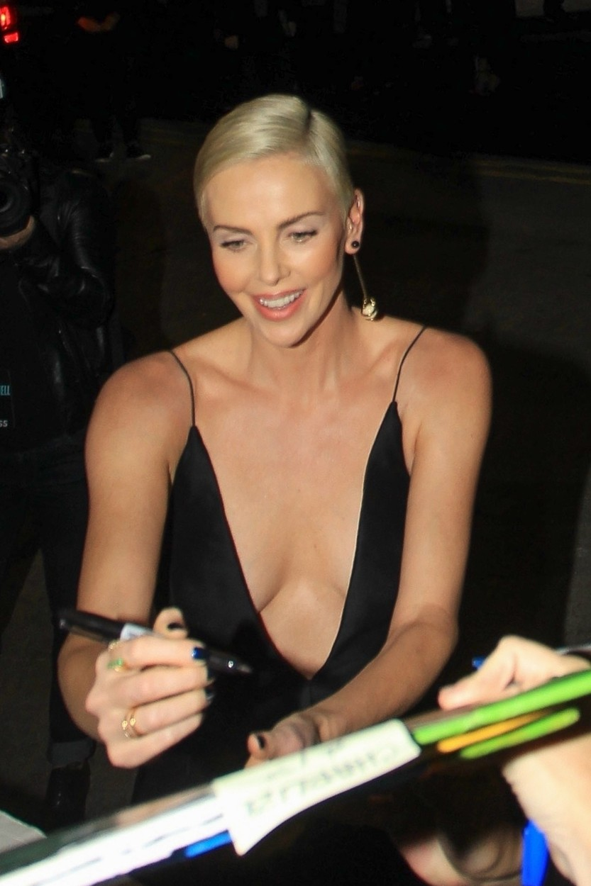 Los Angeles, CA  - Charlize Theron greets fans in a plunging black dress at the Special Screening of 'Bombshell' at the Regency Village in Los Angeles, California.  BACKGRID USA 10 DECEMBER 2019, Image: 487434183, License: Rights-managed, Restrictions: , Model Release: no, Credit line: BACKGRID / Backgrid USA / Profimedia