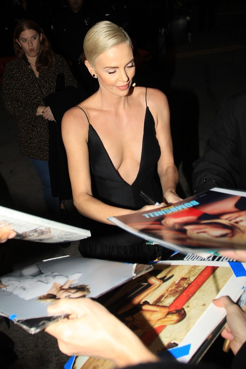 Los Angeles, CA  - Charlize Theron greets fans in a plunging black dress at the Special Screening of 'Bombshell' at the Regency Village in Los Angeles, California.  BACKGRID USA 10 DECEMBER 2019, Image: 487434189, License: Rights-managed, Restrictions: , Model Release: no, Credit line: BACKGRID / Backgrid USA / Profimedia